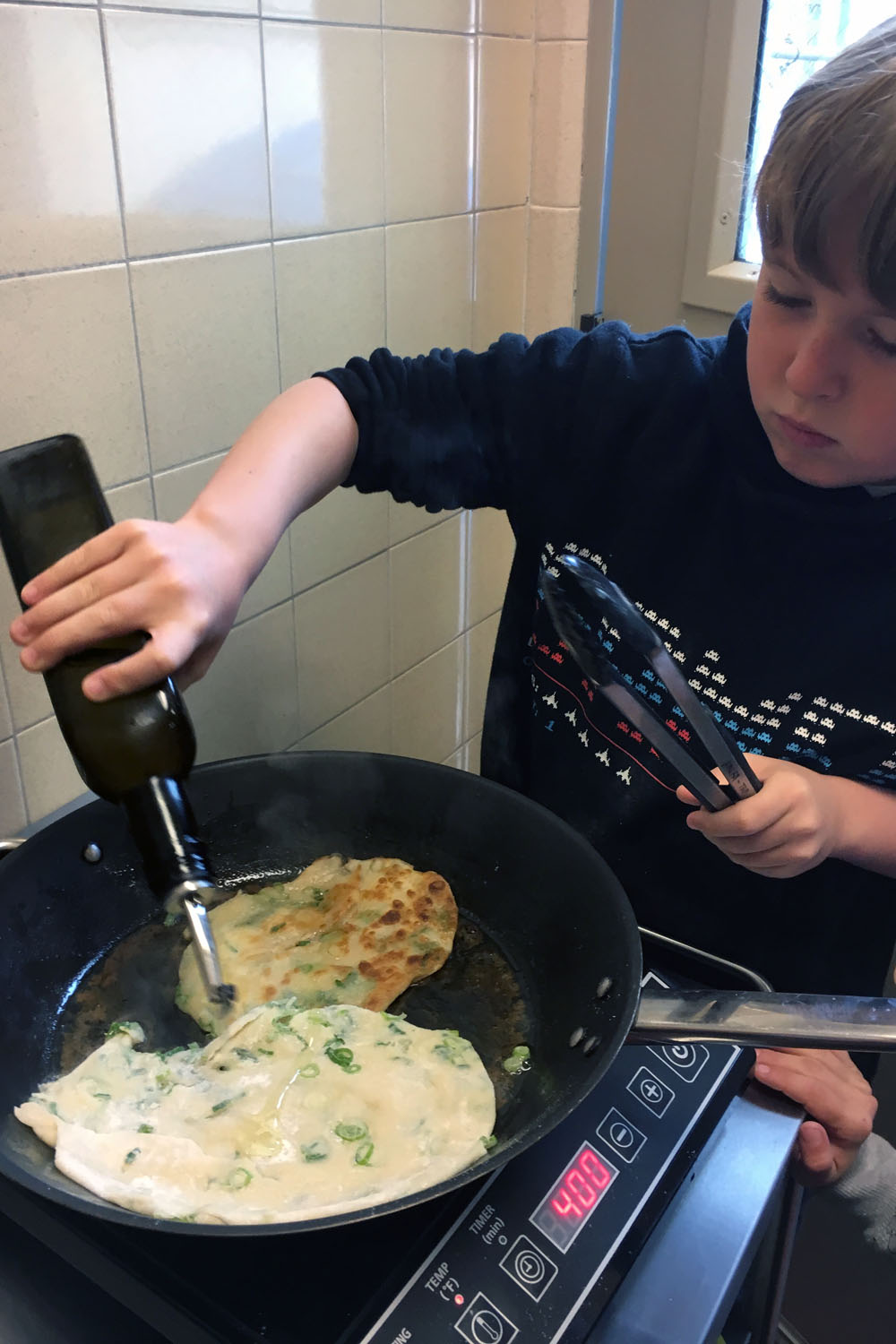 Students really enjoyed adding more oil and flipping the pancakes as they turned golden brown.