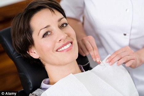 Woman Smile Dentist Chair.jpg