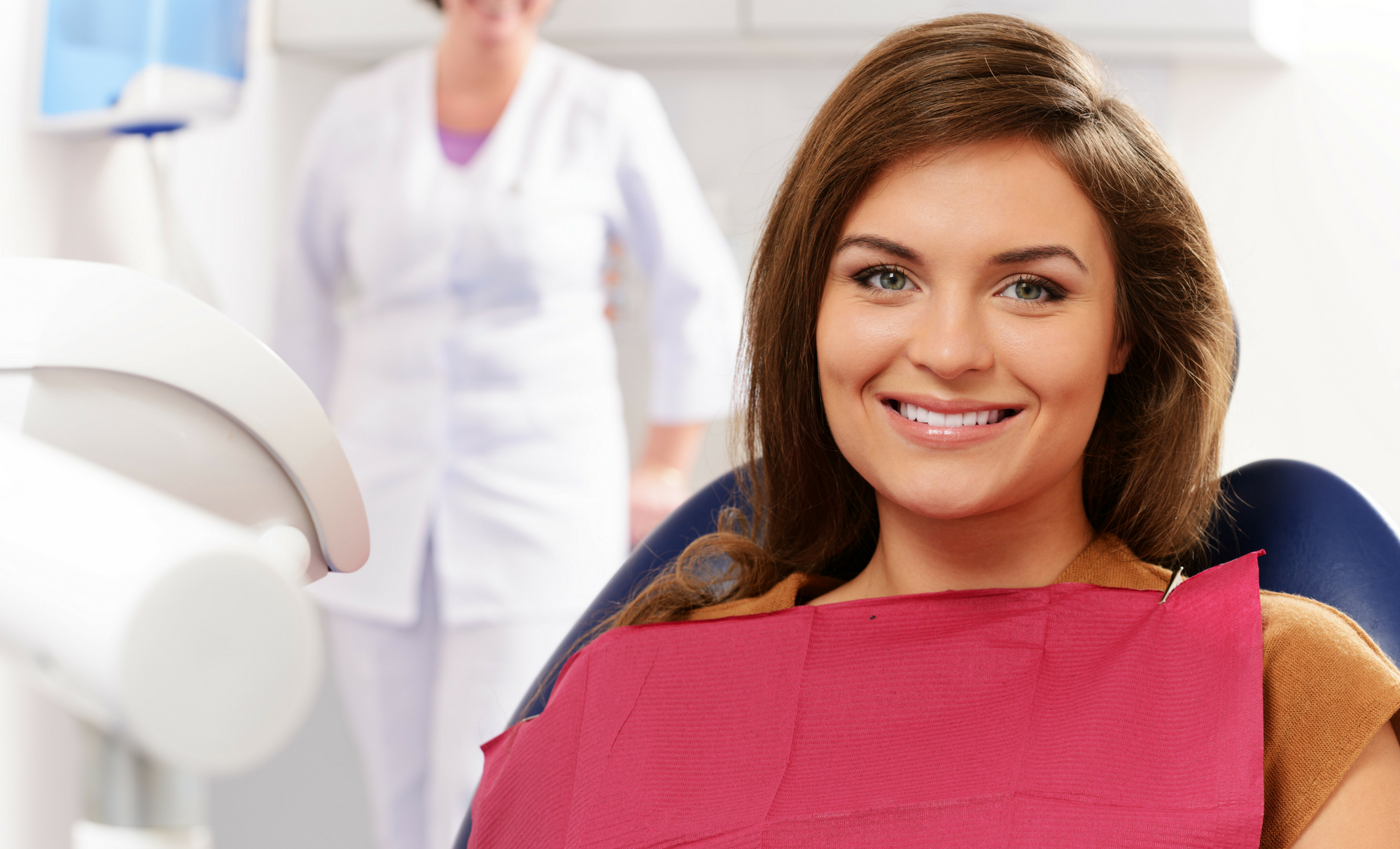 woman with health smile at dentist 2.png