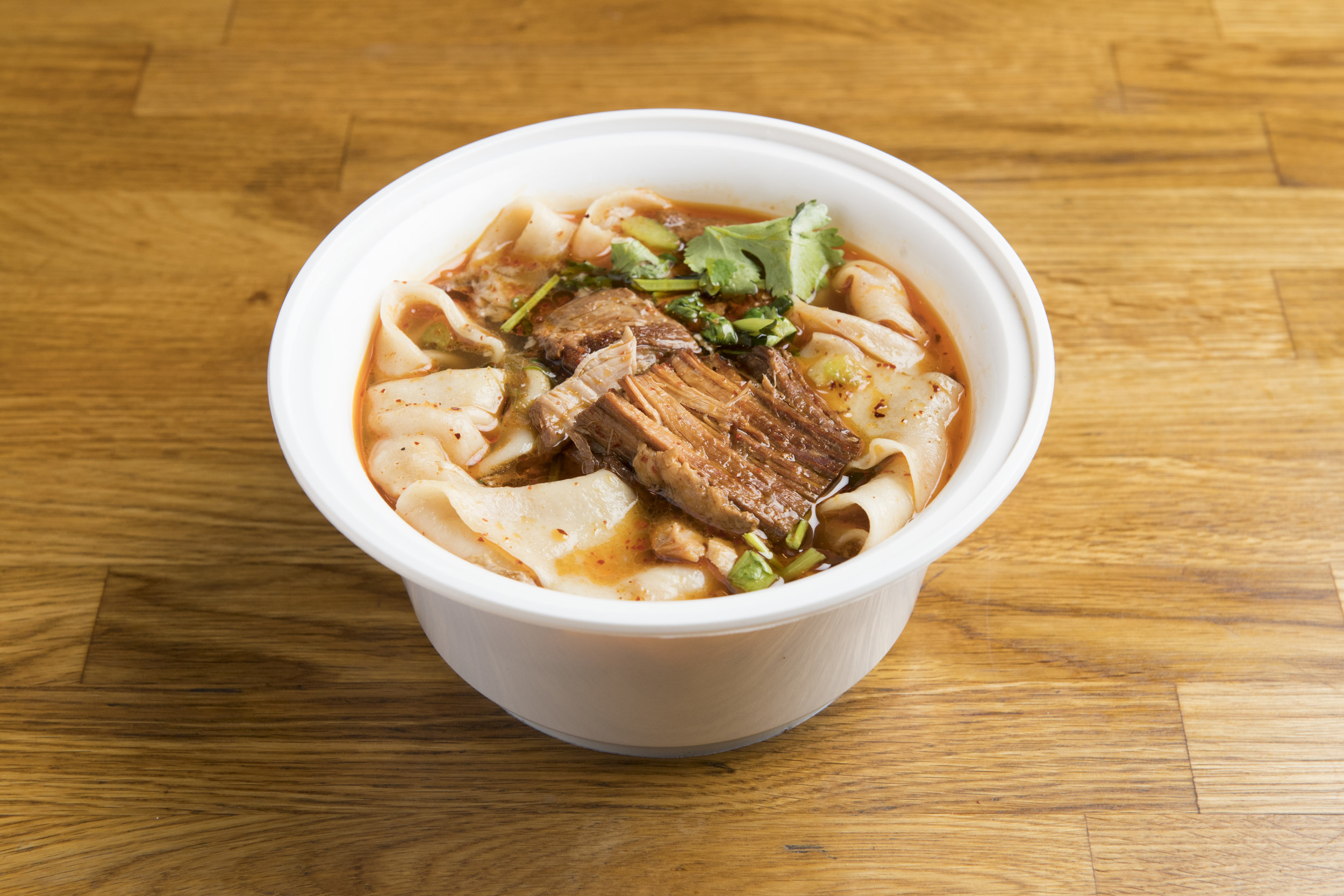 [NS4] Stewed Pork Hand-Ripped Noodles in Soup   Our biangbiang wide, hand-ripped noodles, topped with pulled pieces of stewed lean pork belly meat, in a noodle broth containing its own soy-sauce based stew.