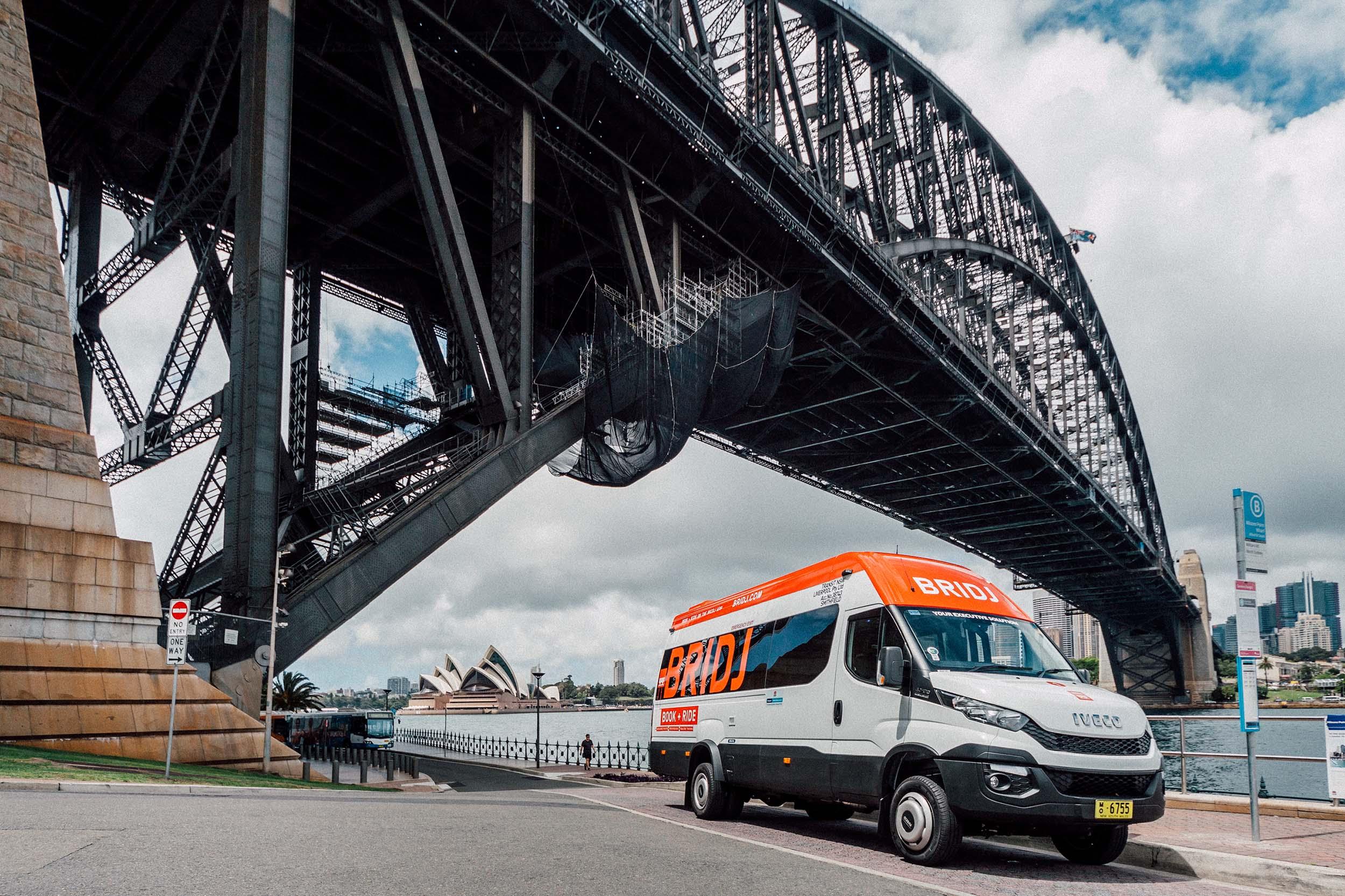 A BRIDJ bus under the Sydney Harbour Bridge