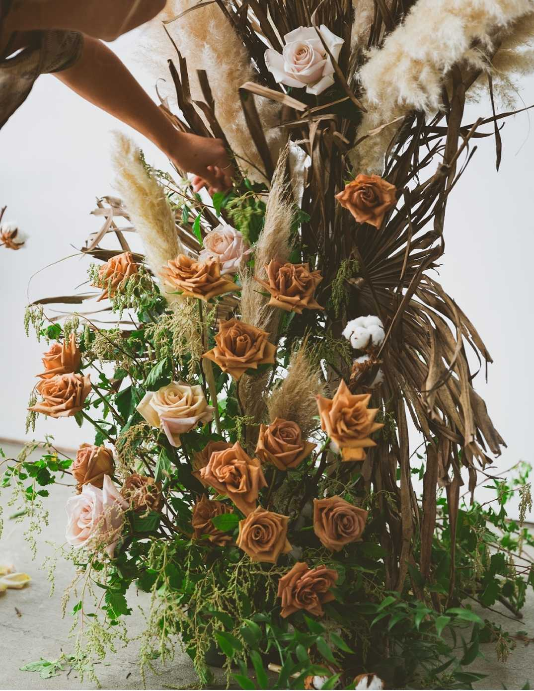Taupe and blush roses in a minimalist floral installation rustic industrial natural light wedding venue Victoria, B.C floral designer