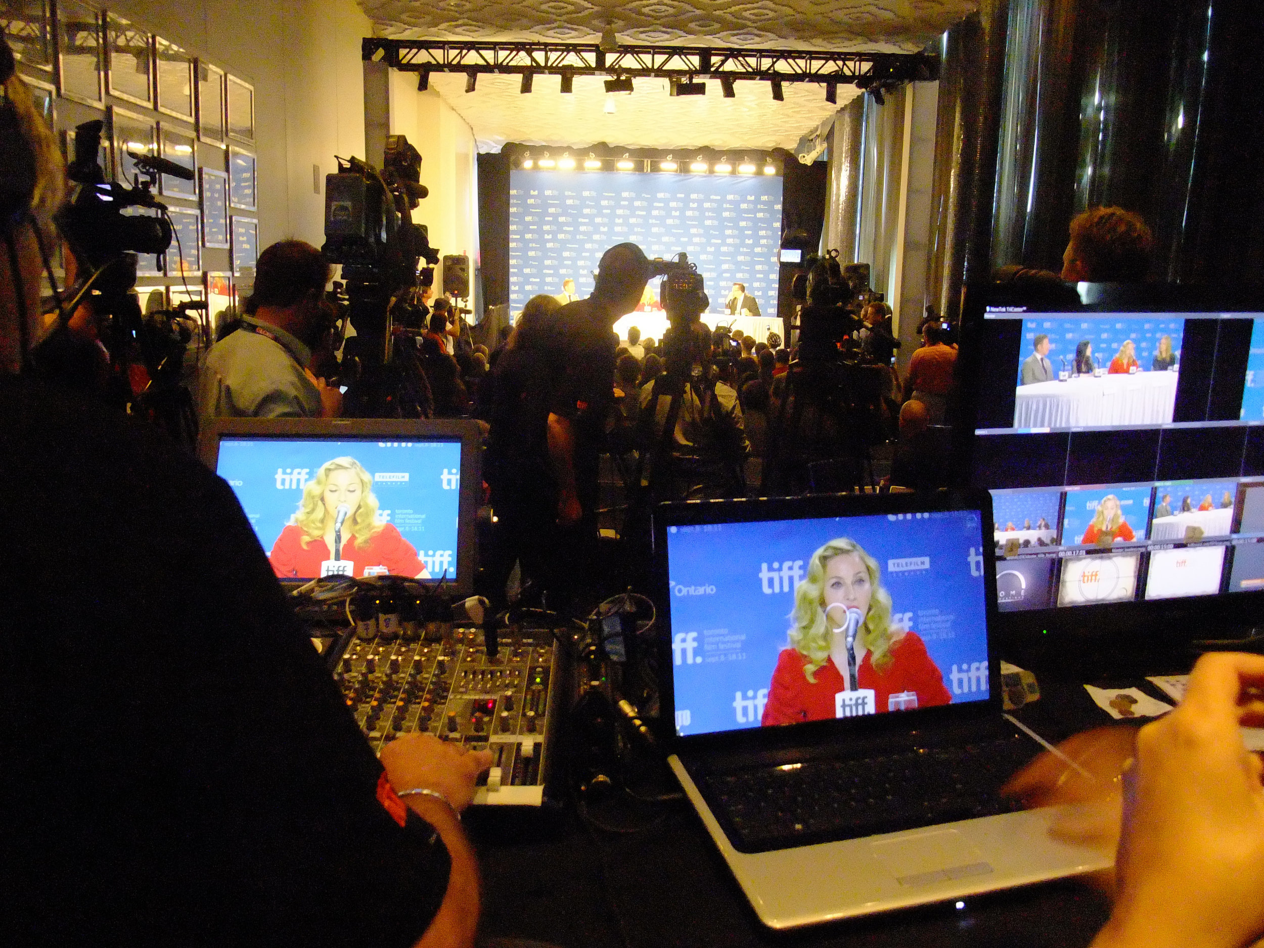 Grassby & Associates designed the media interview set for the festival including the building of the interview table. Madonna on set.