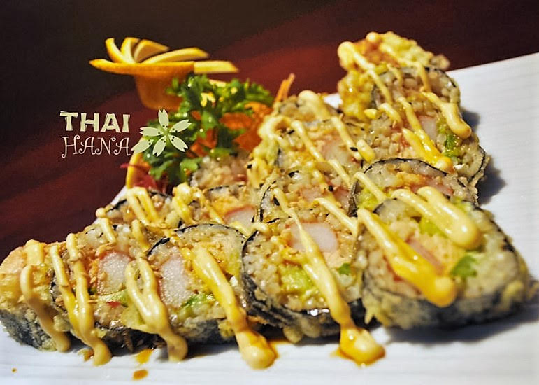 Super Crunch Roll - Krab, Eel, Salmon, Cream Cheese, Avocado and Asparagus.