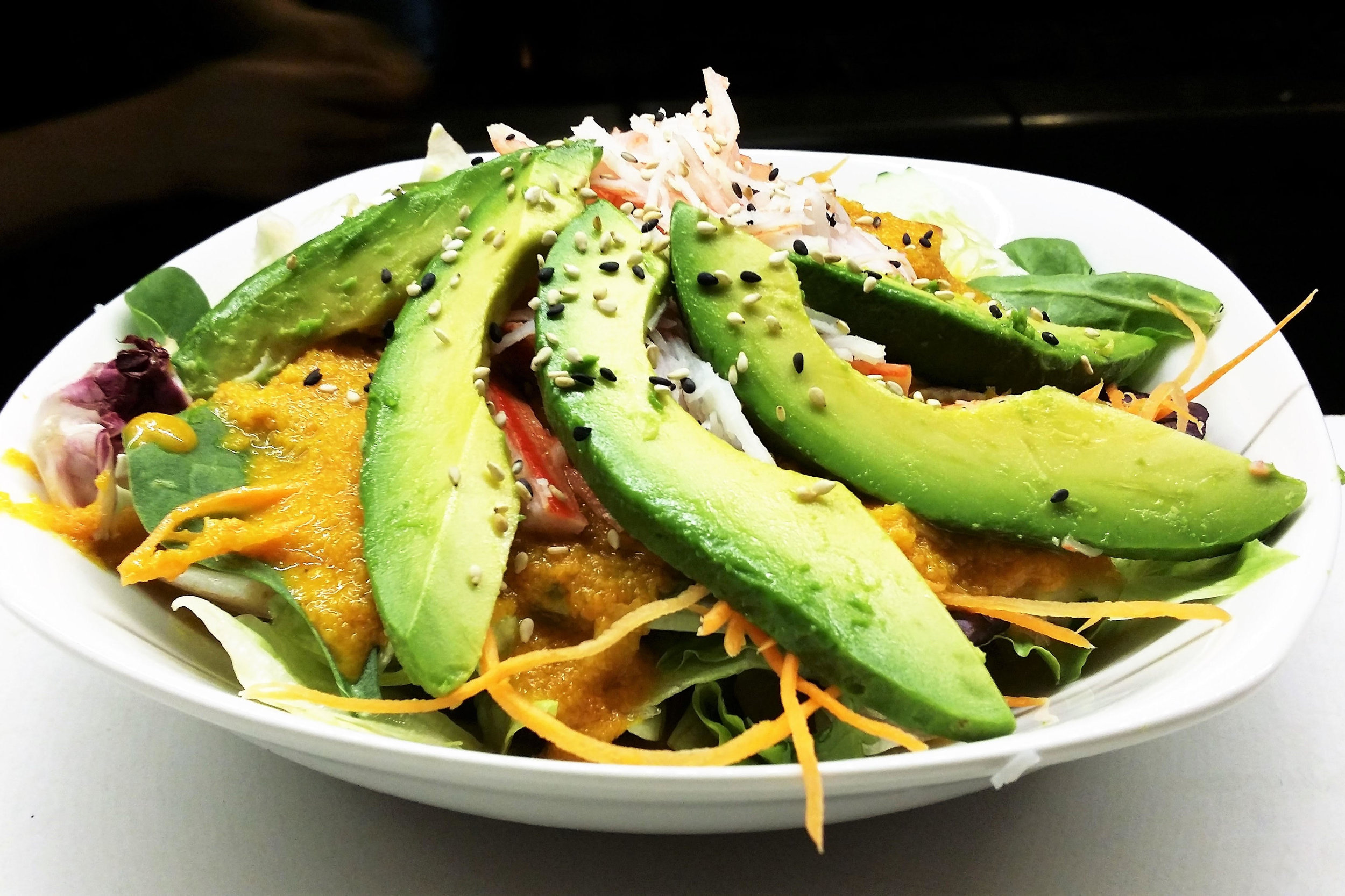 Avocado Krab Salad - Green salad topped with Avocado and Krab with ginger dressing.