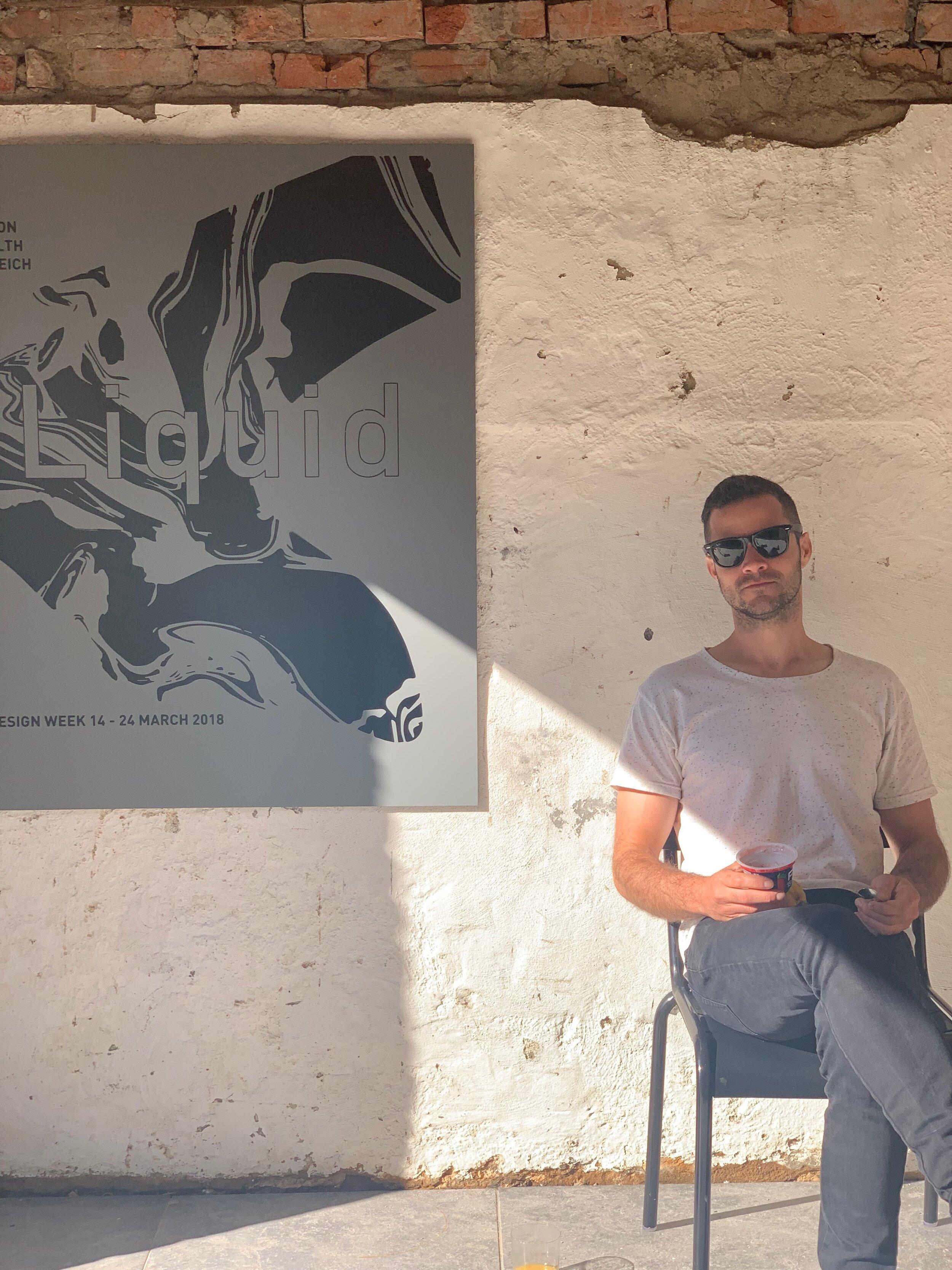 exhibition curator and furniture designer Elliot Bastianon with artwork decal