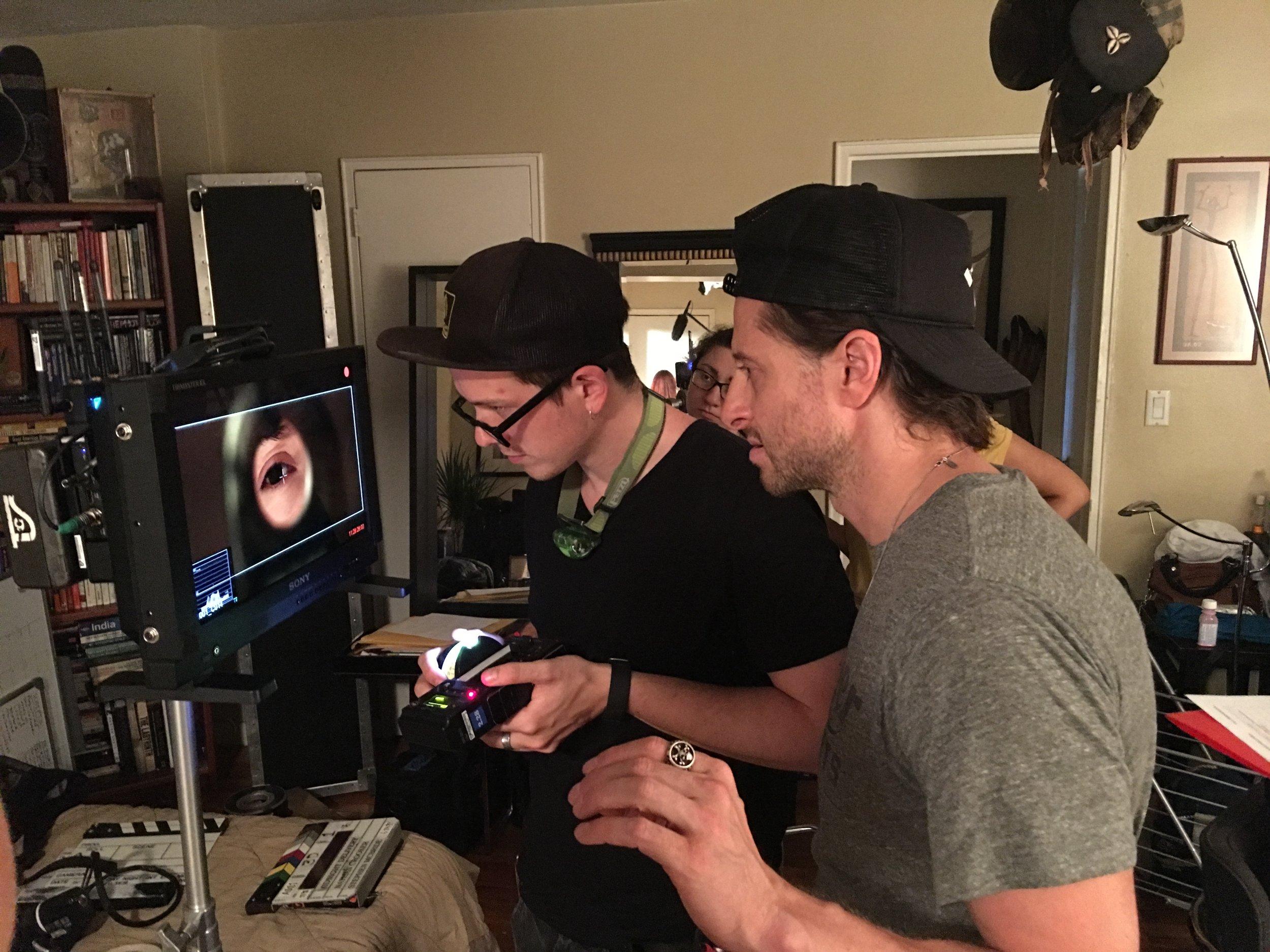 "Director Nathan Crooker and 1st AC Curran Banach set the ""peephole""shot."