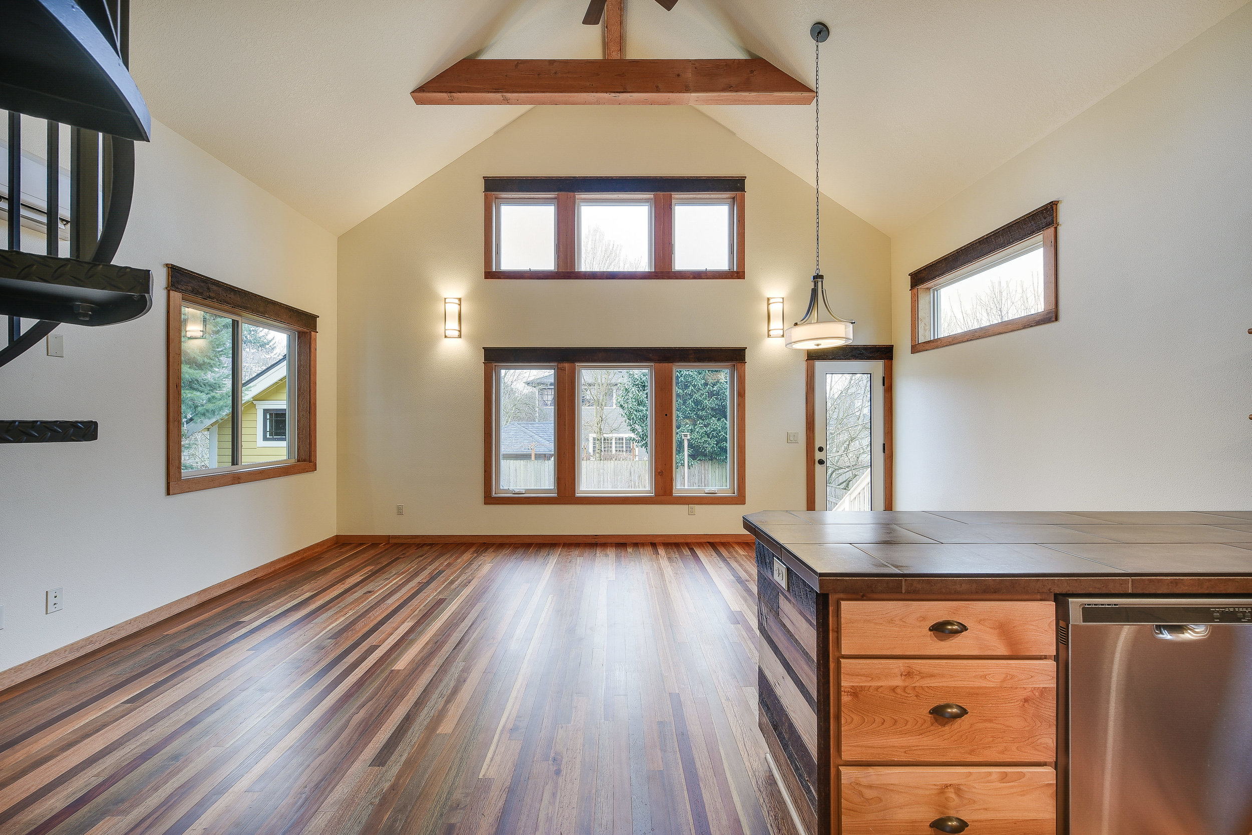 Kitchen & dining room with reclaimed wood floors & trim