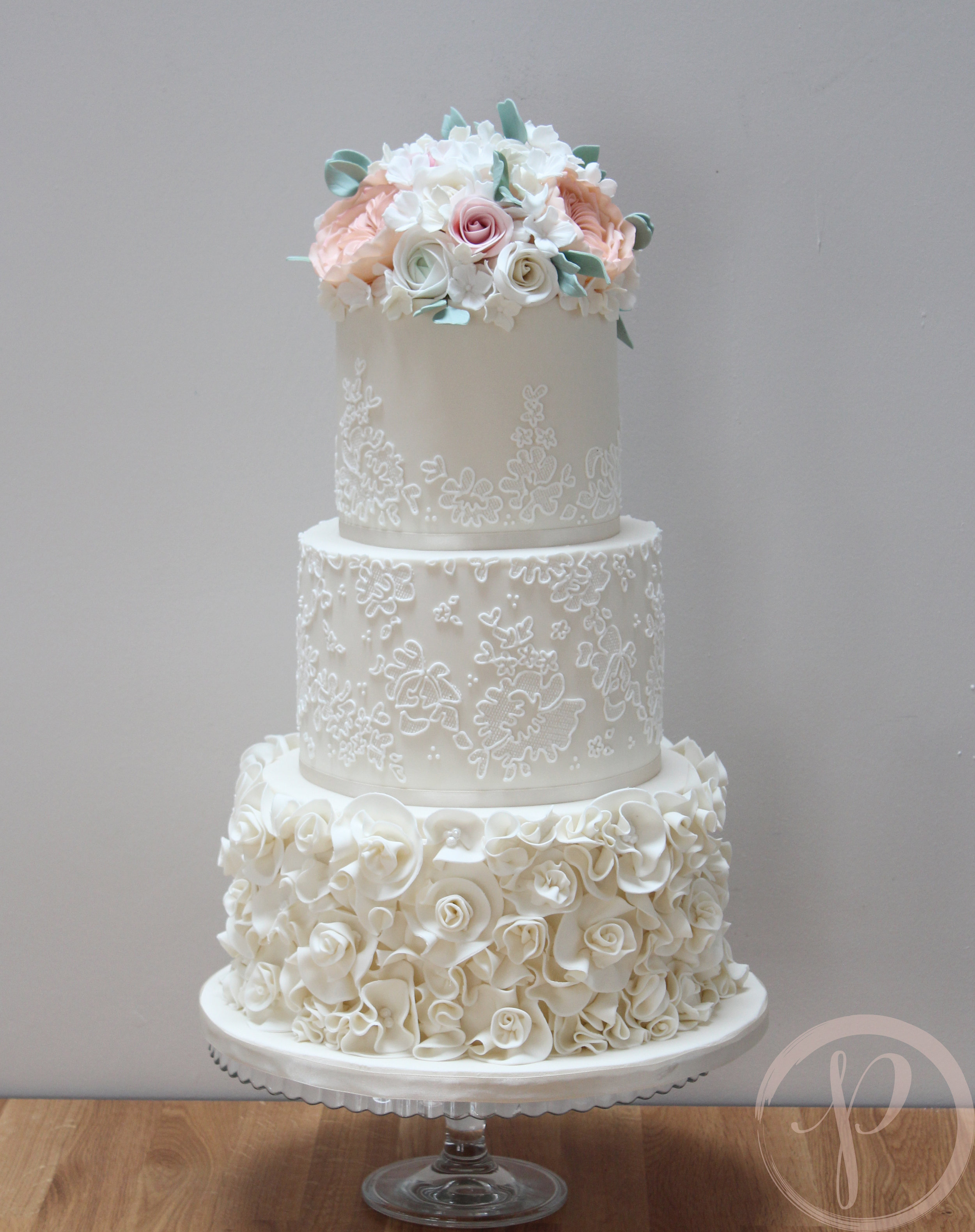 ruffle and lace wedding cake with sugar flowers.jpg