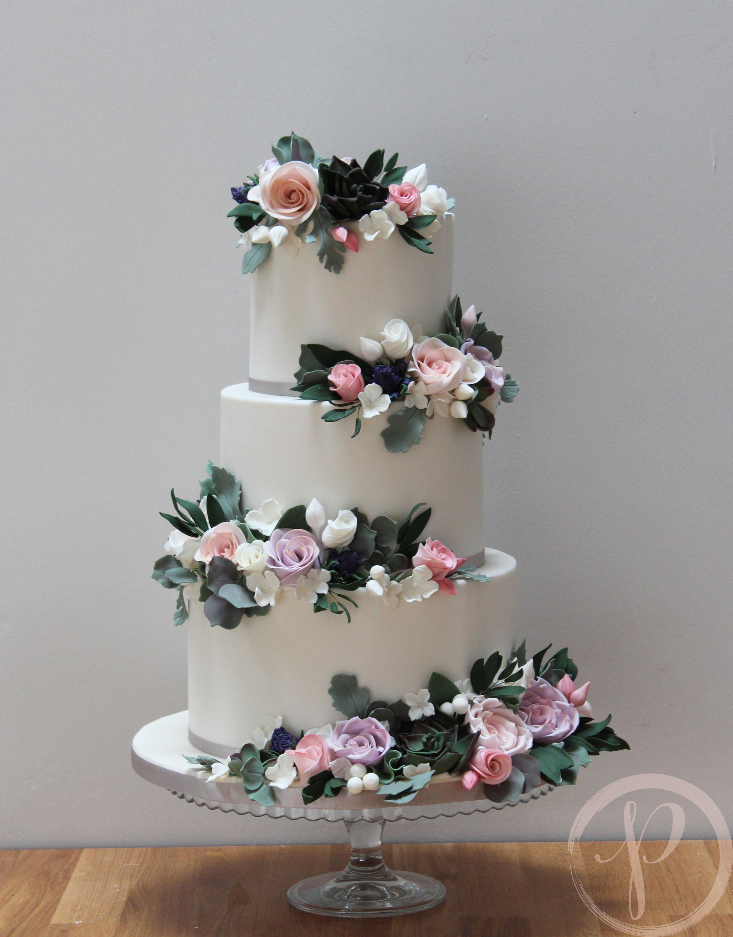 wedding cake with sugar flowers succulents foliage roses thistles.jpg