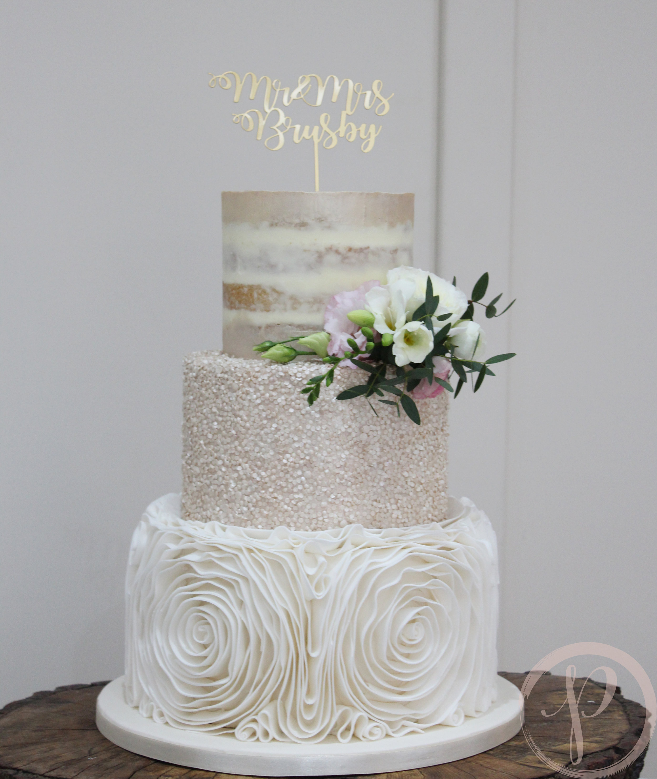 ruffle rose wedding cake with champagne sequins and semi naked tier.jpg
