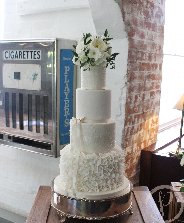 ruffle sparkle elegant wedding cake with fresh flowers.jpg