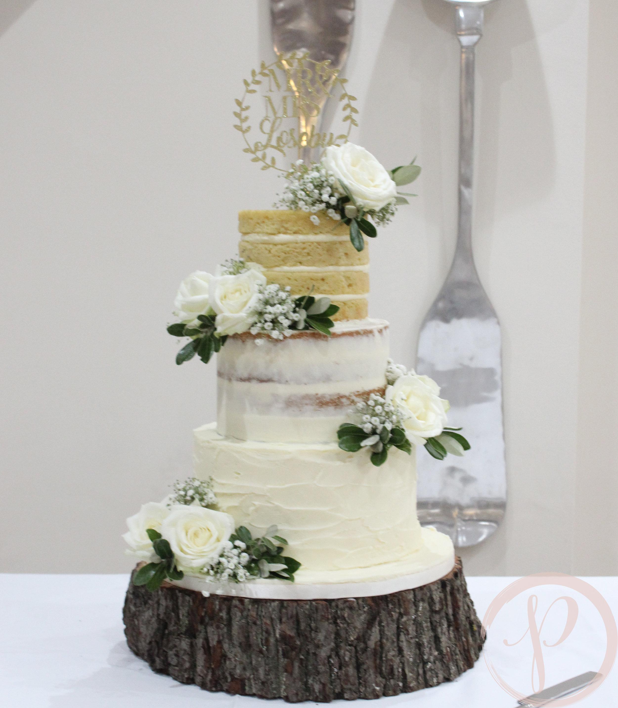 gradiented naked wedding cake with beautiful white flowers.jpg