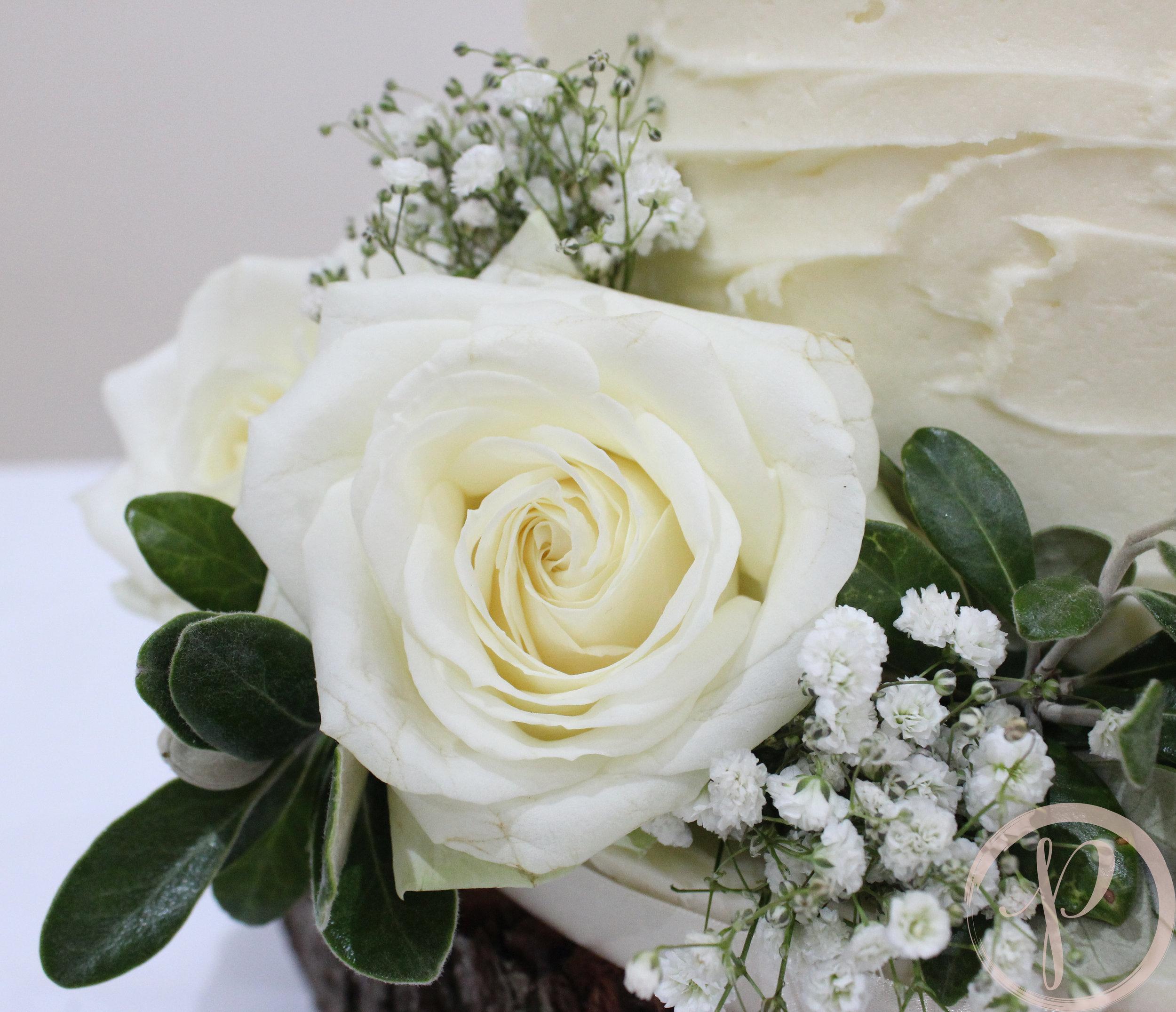 white rose buttercream wedding cake.jpg