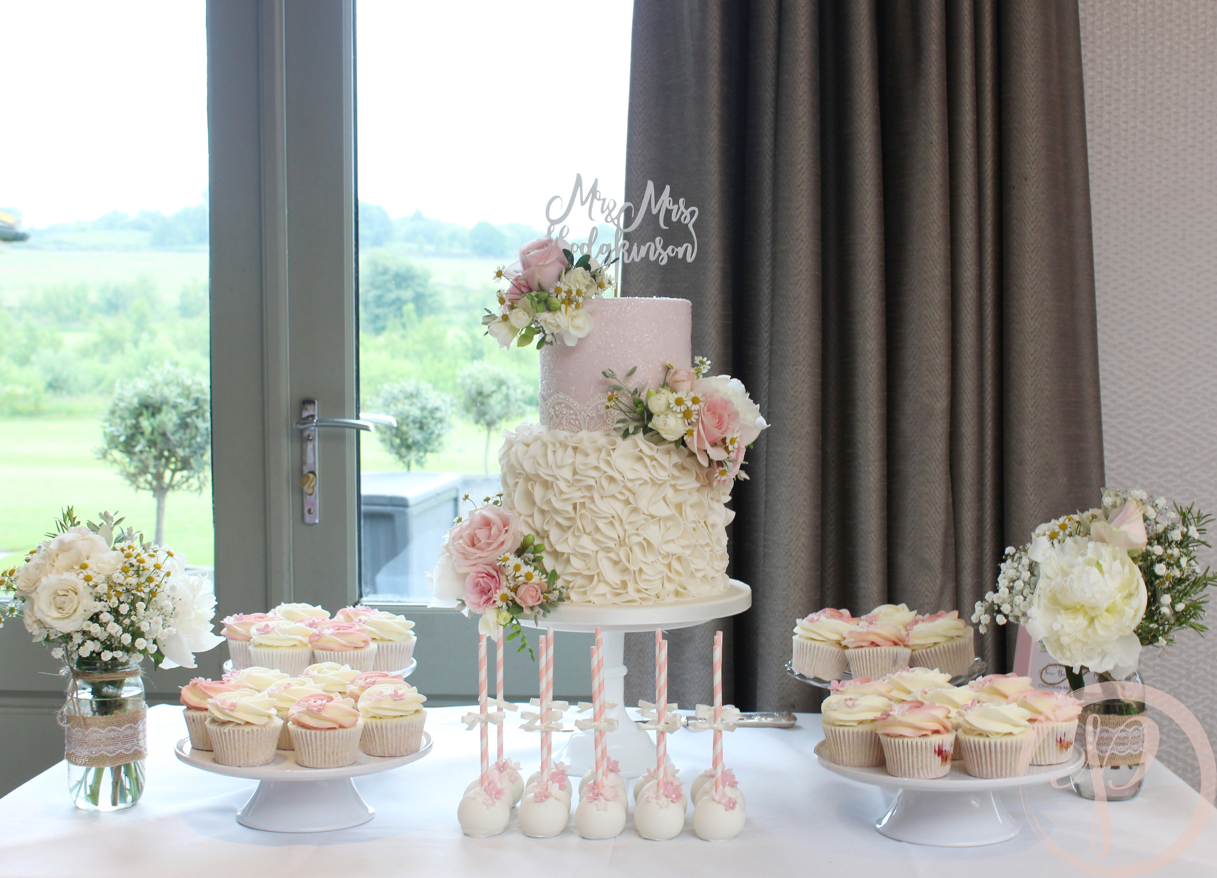 blush ruffle wedding cake table cupcakes cakepops fresh flowers.jpg
