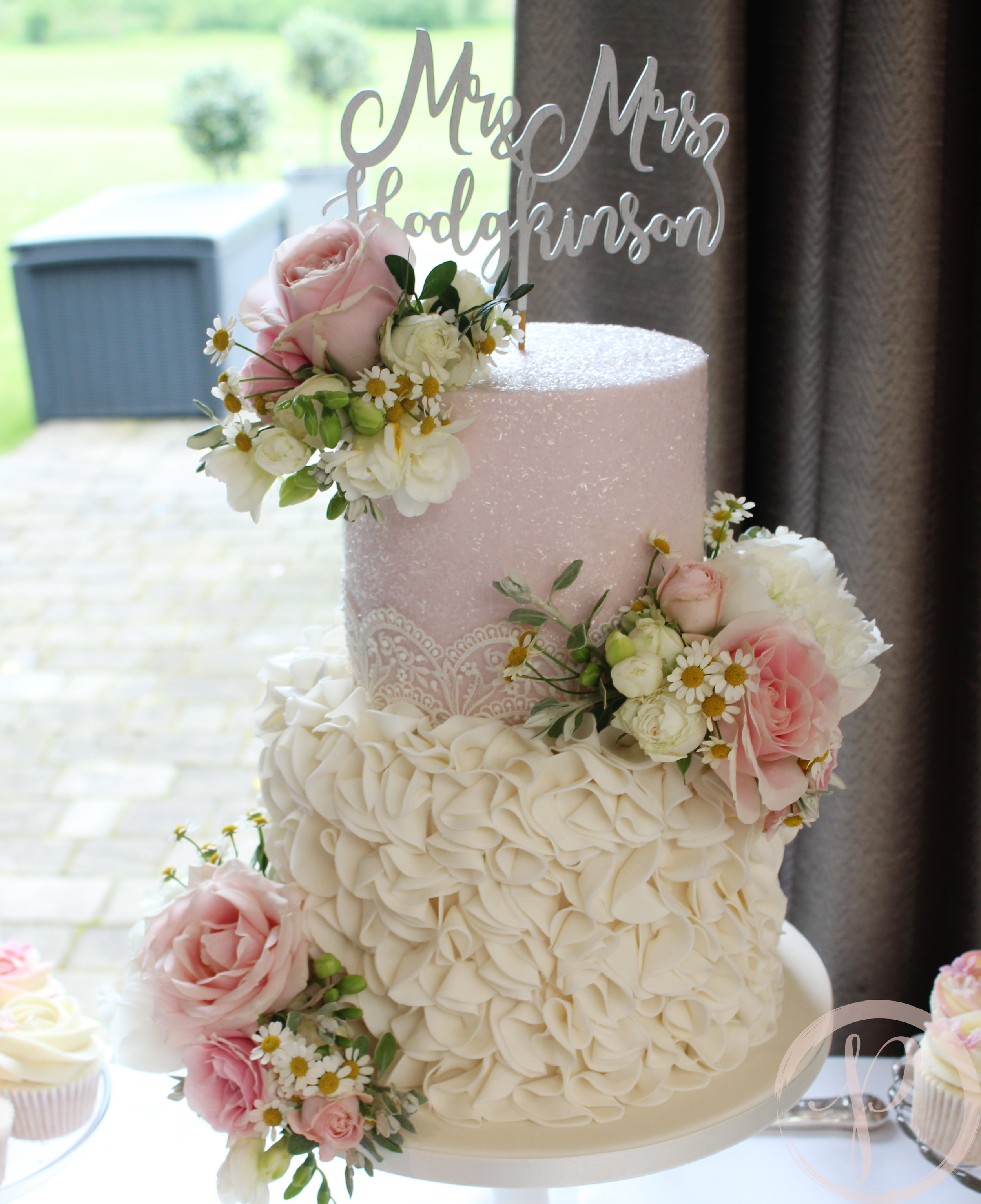 blush sparkle and ruffle wedding cake with fresh flowers.jpg