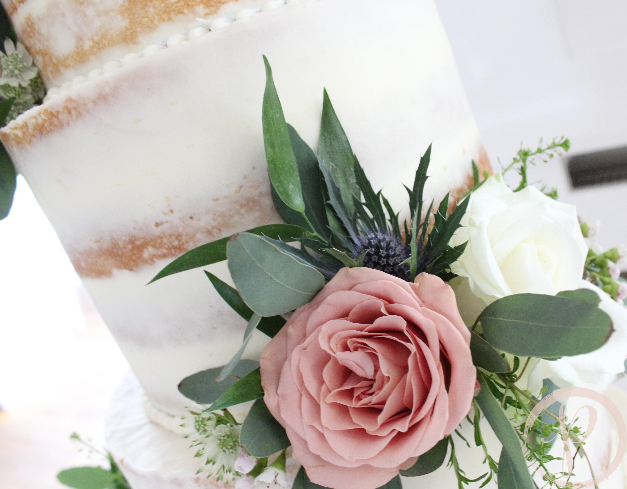 dusky pink roses semi naked wedding cake.jpg