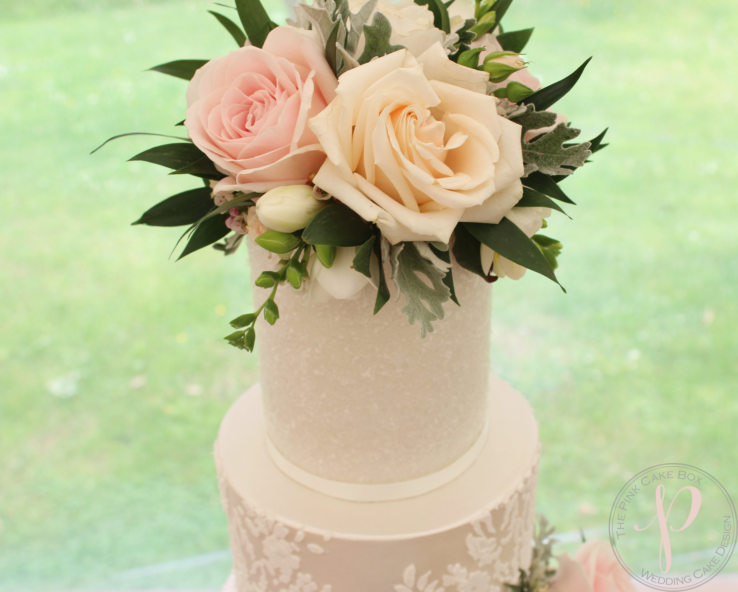 beautifu sparkle wedding cake with fresh flowers.jpg