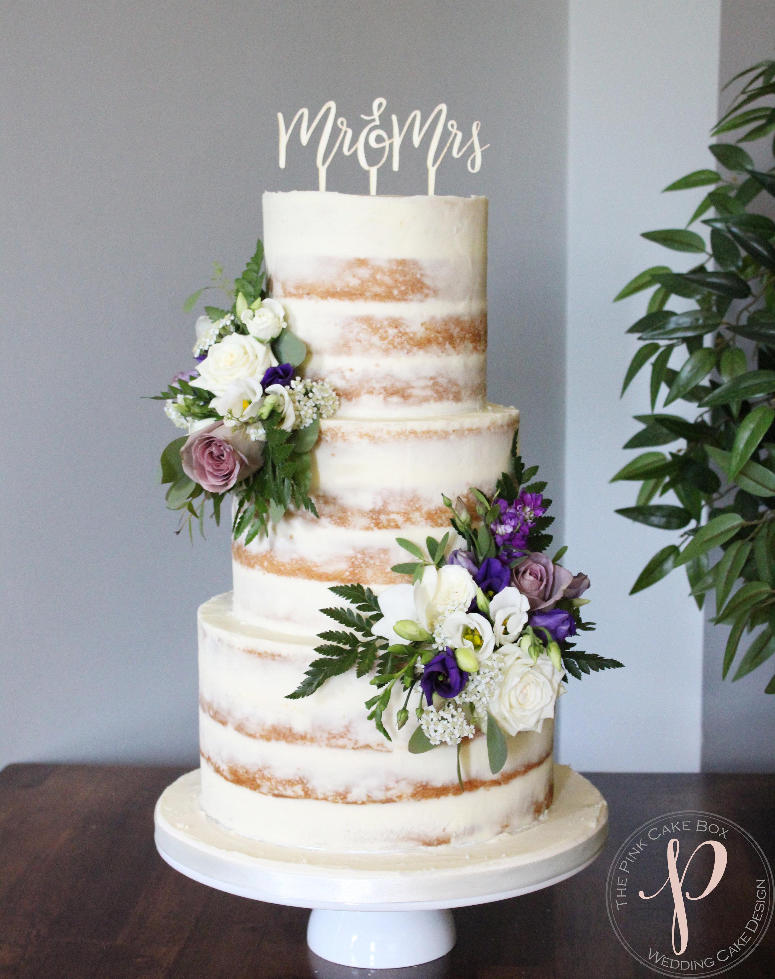 semi naked wedding cake with purple lilac flowers.jpg