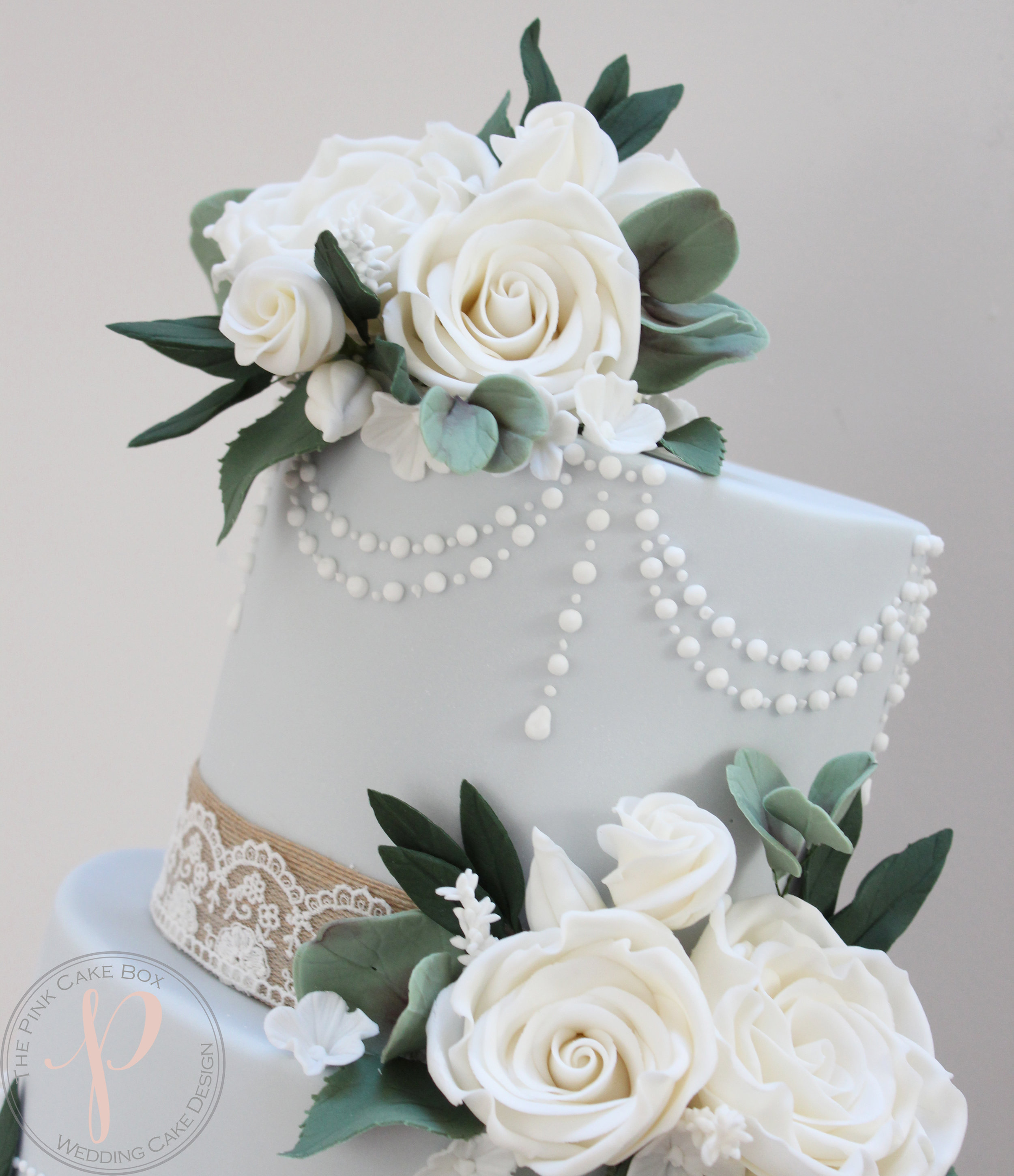 vintage blue wedding cake pearls and sugar flowers.jpg