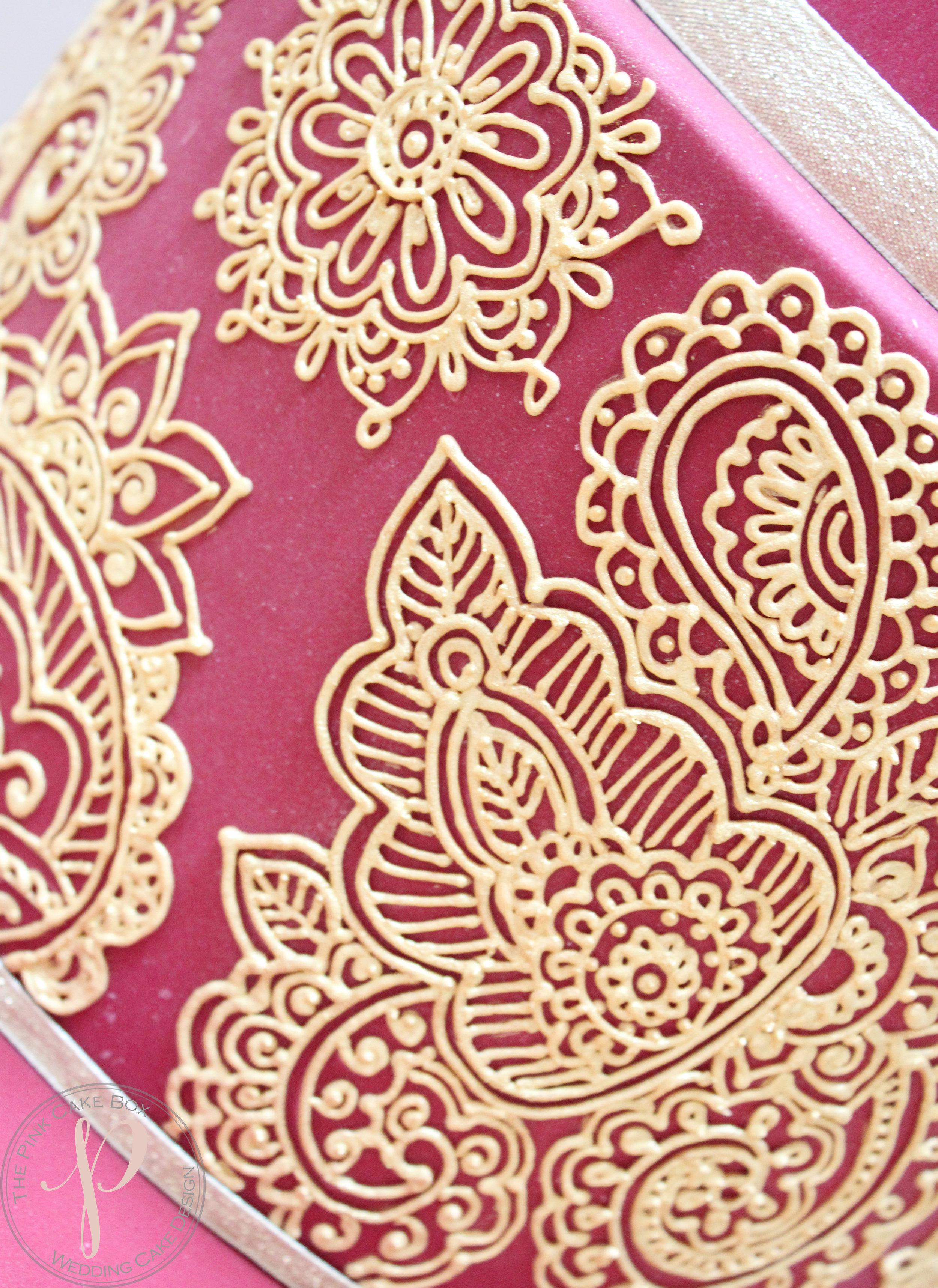 ruby gold wedding cake henna piping.jpg