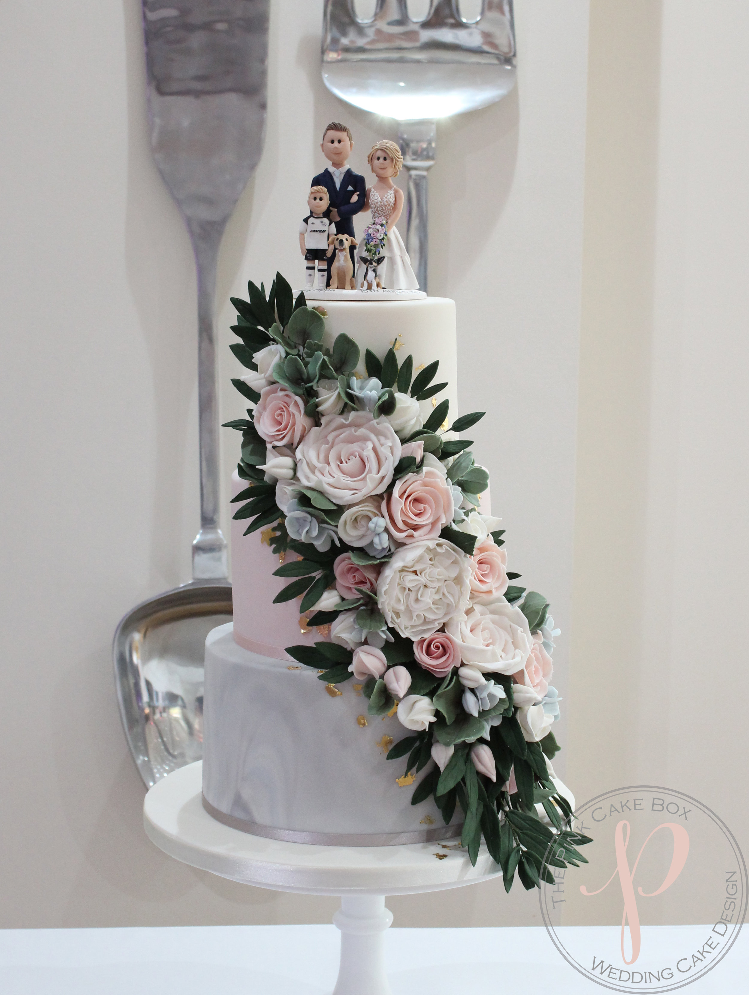 floral cascade wedding cake with topper.jpg