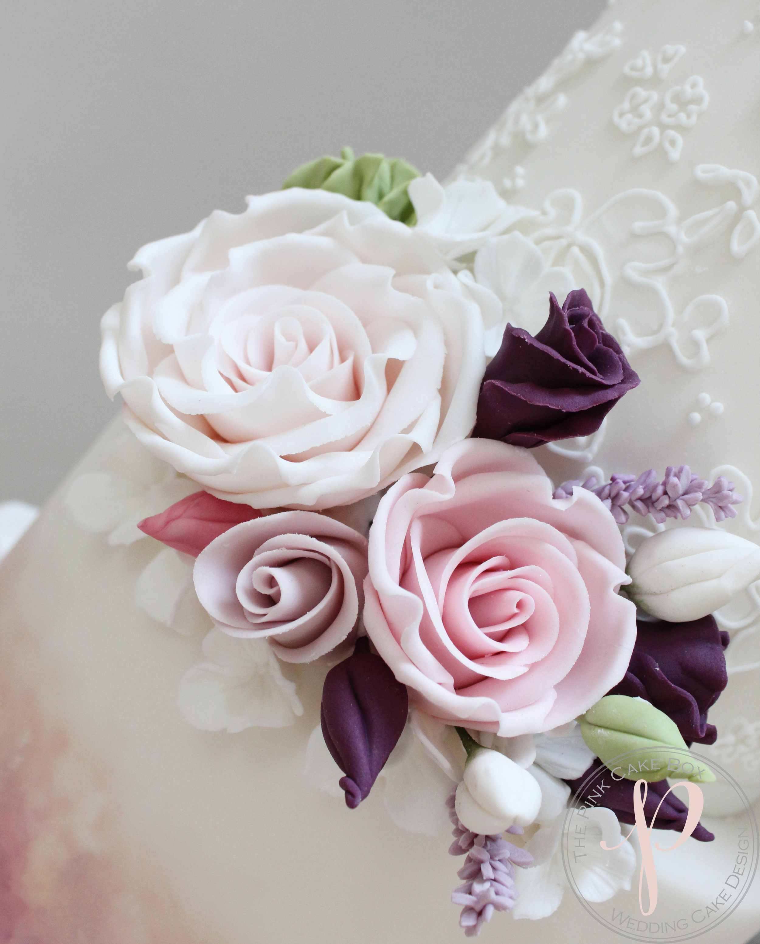 sugar flowers pink lilac wedding cake.jpg