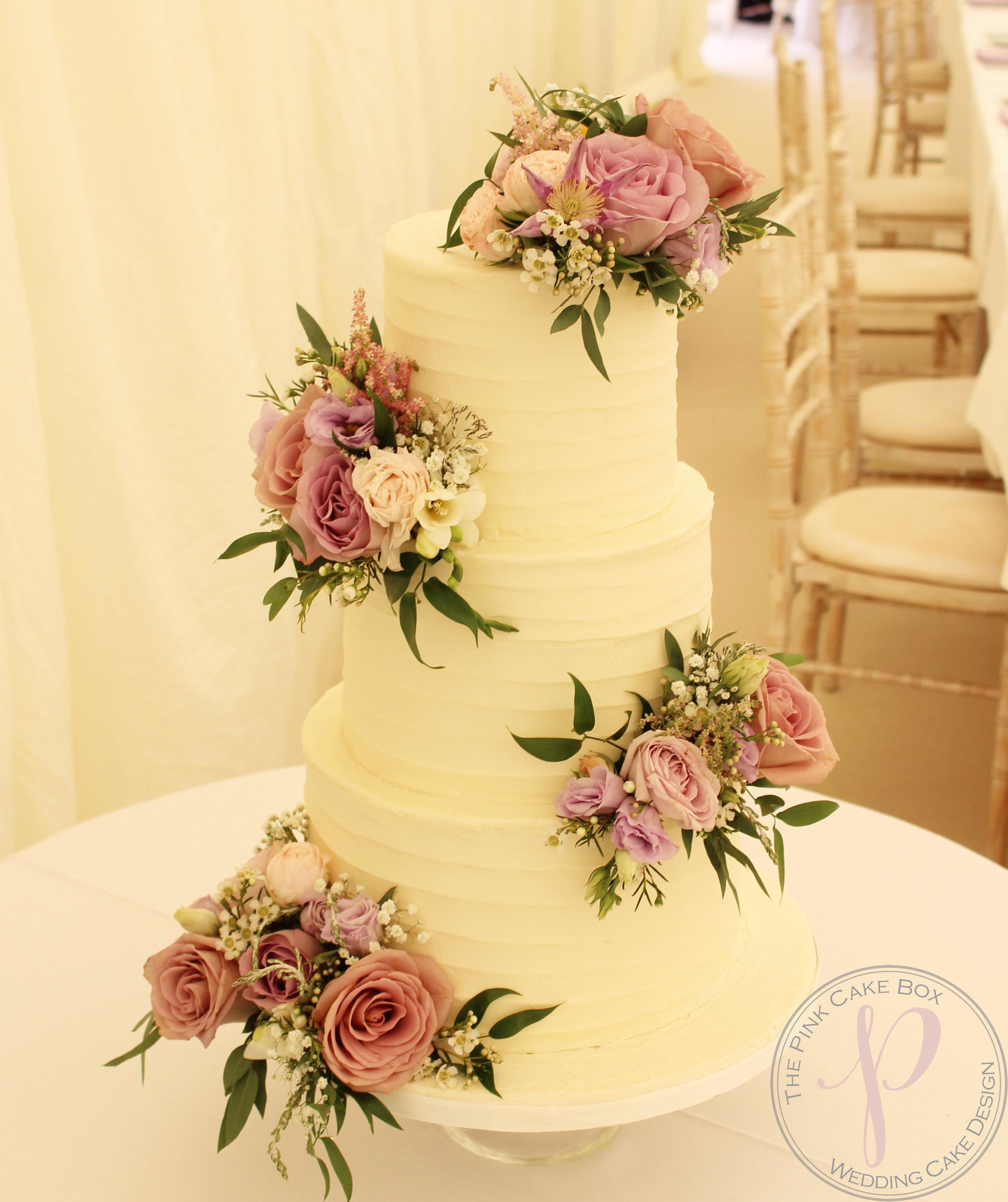 buttercream wedding cake lilac pink roses.jpg