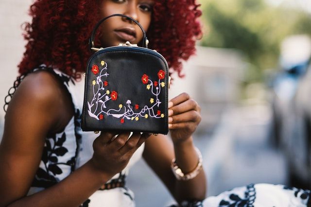 pexels black woman holding purse.jpg