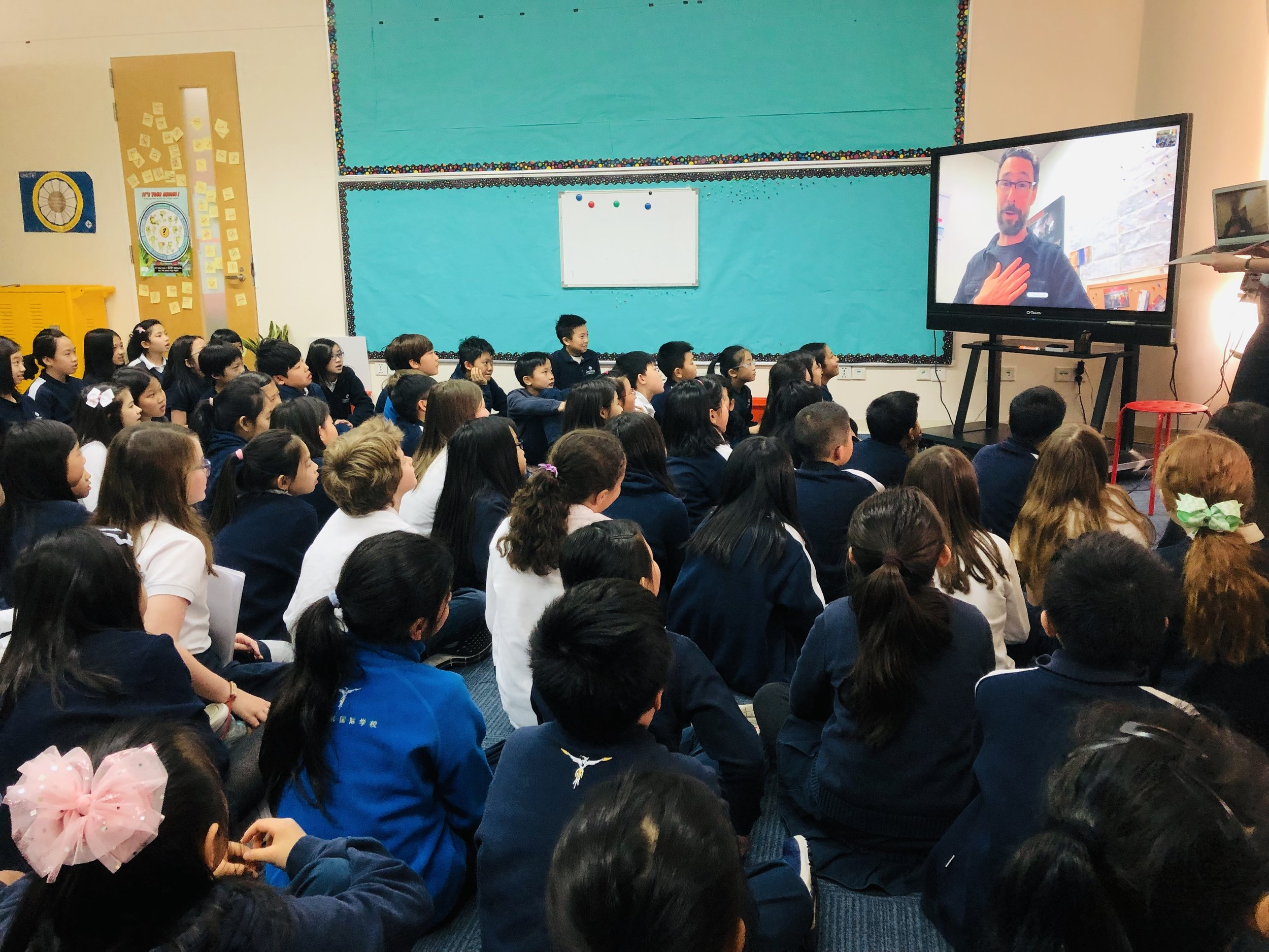 Out of the Blocks journalist Aaron Henkin Skypes in to Grade 4 to encourage students to find stories all around them.