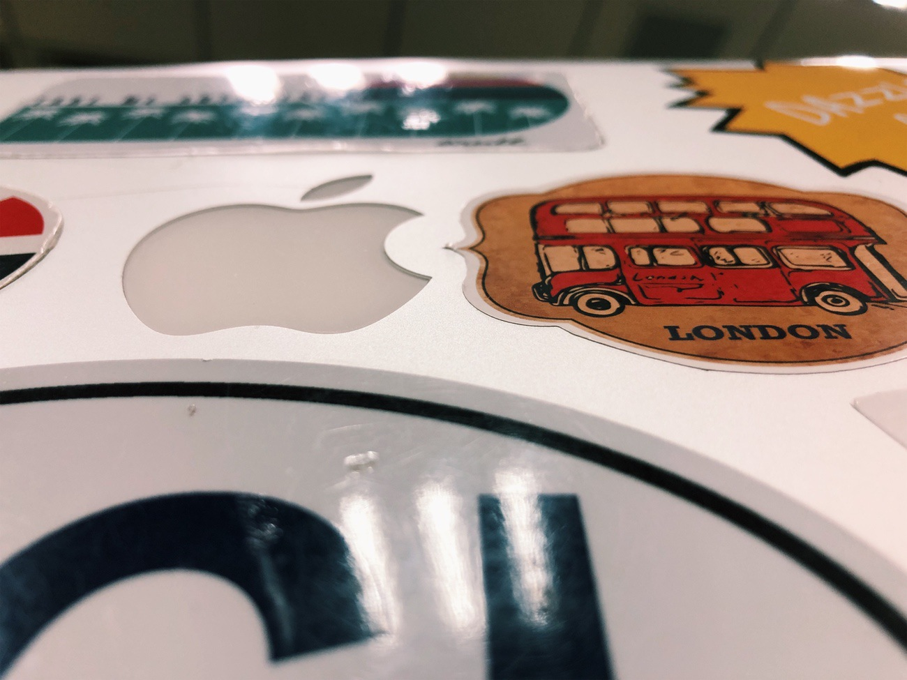 Identification of  one's own  computer in a sea of Apple products is just one of the many reasons people apply decals to their machines. ((image: Hannah R.,  Concordia Applied Journalism )