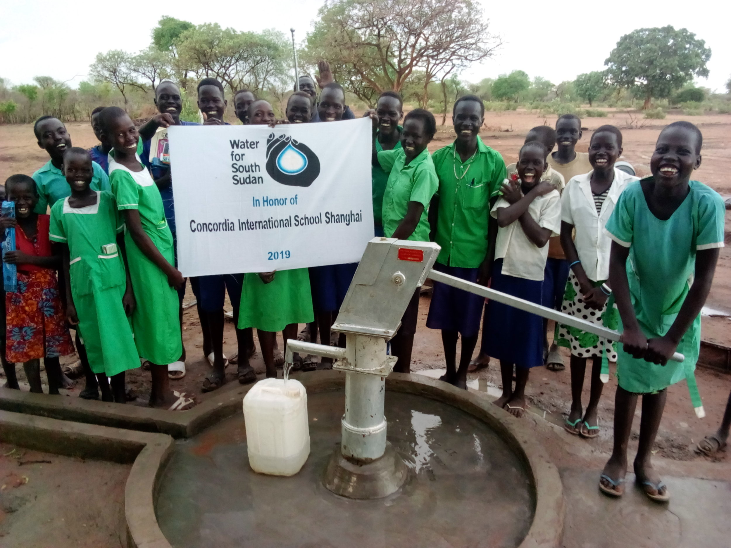 A celebration of the opening of the Concordia well in the village of Mayen-Ruel, Gogrial, South Sudan.