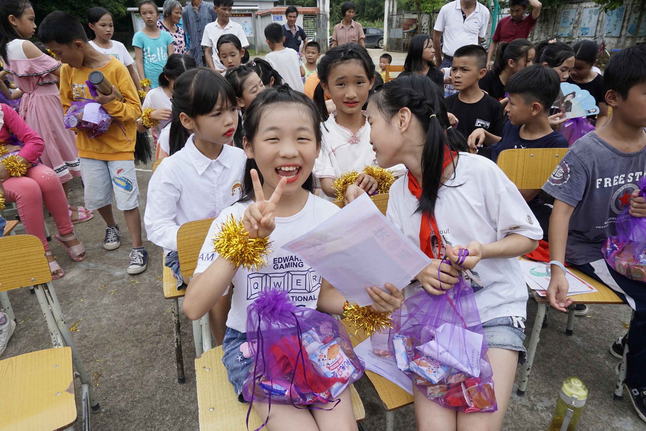 Students in Guangzhou receiving craft supplies purchased by Grade 1 students at Concordia.