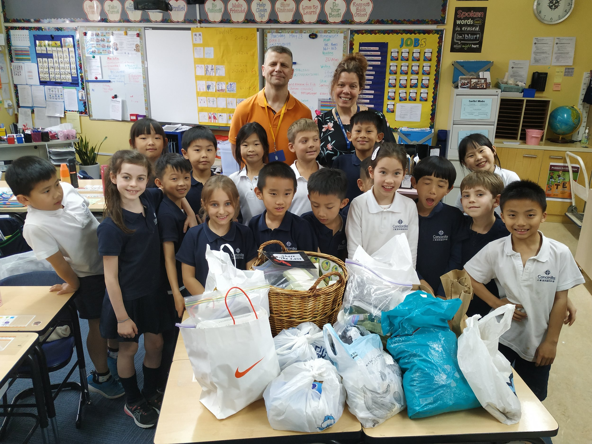 Gerie from Home Sweet Home and Corinna Raasch's grade 2 class. The students gathered up hotel toiletry items throughout the year to donate to Home Sweet Home, and then decided to engage in a Service Learning experience to teach parents about homelessness in Shanghai.