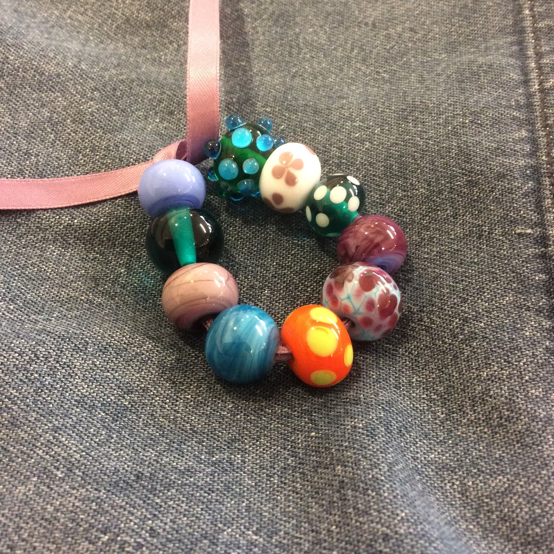 Clare's finished beads strung on ribbon in the order in which she made them. It's lovely to be able to follow the journey from the simplest bead to the most complicated!