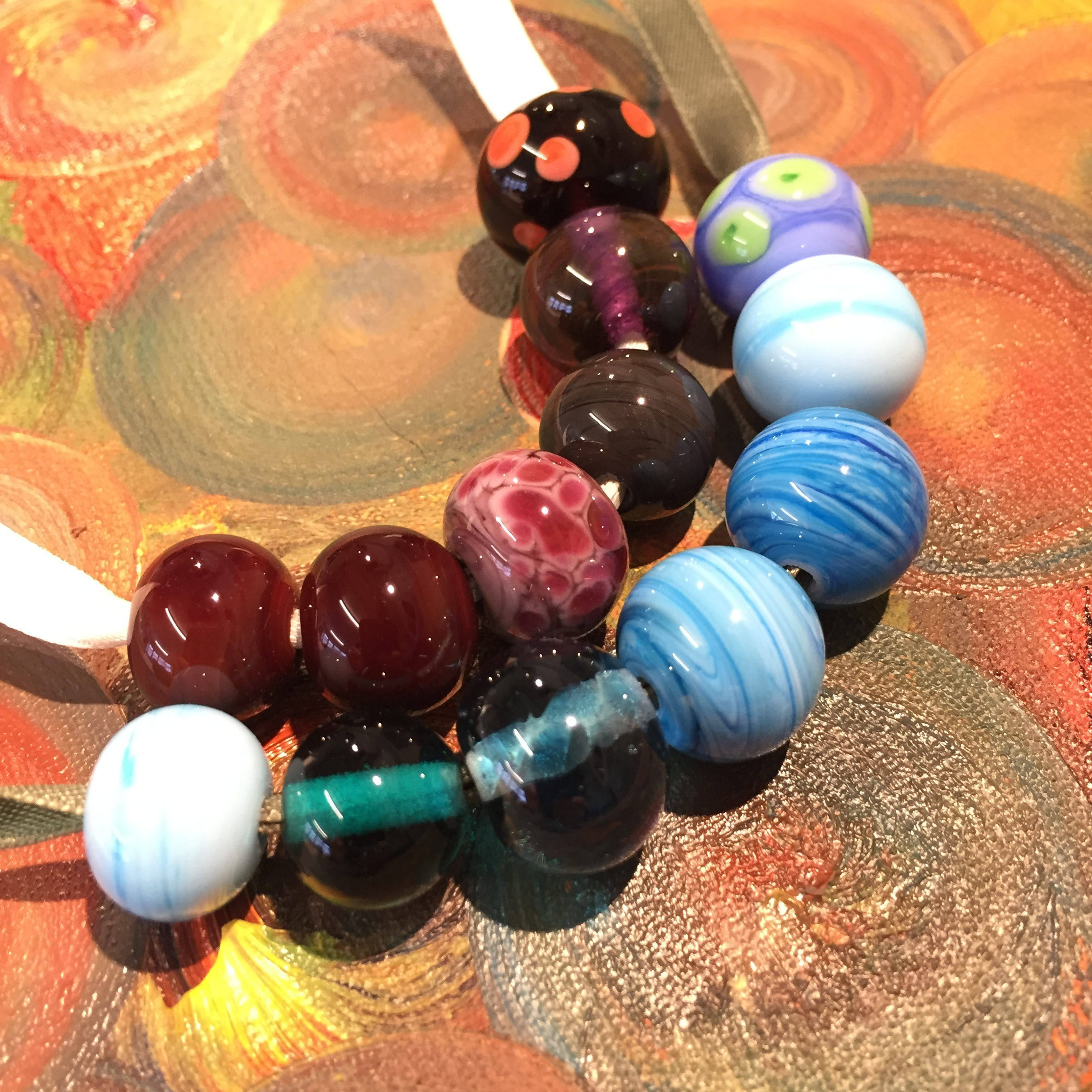 Both ladies created gorgeous beads! Charlie went for sea colours, and designs included frit, dots and gravity-twisting.