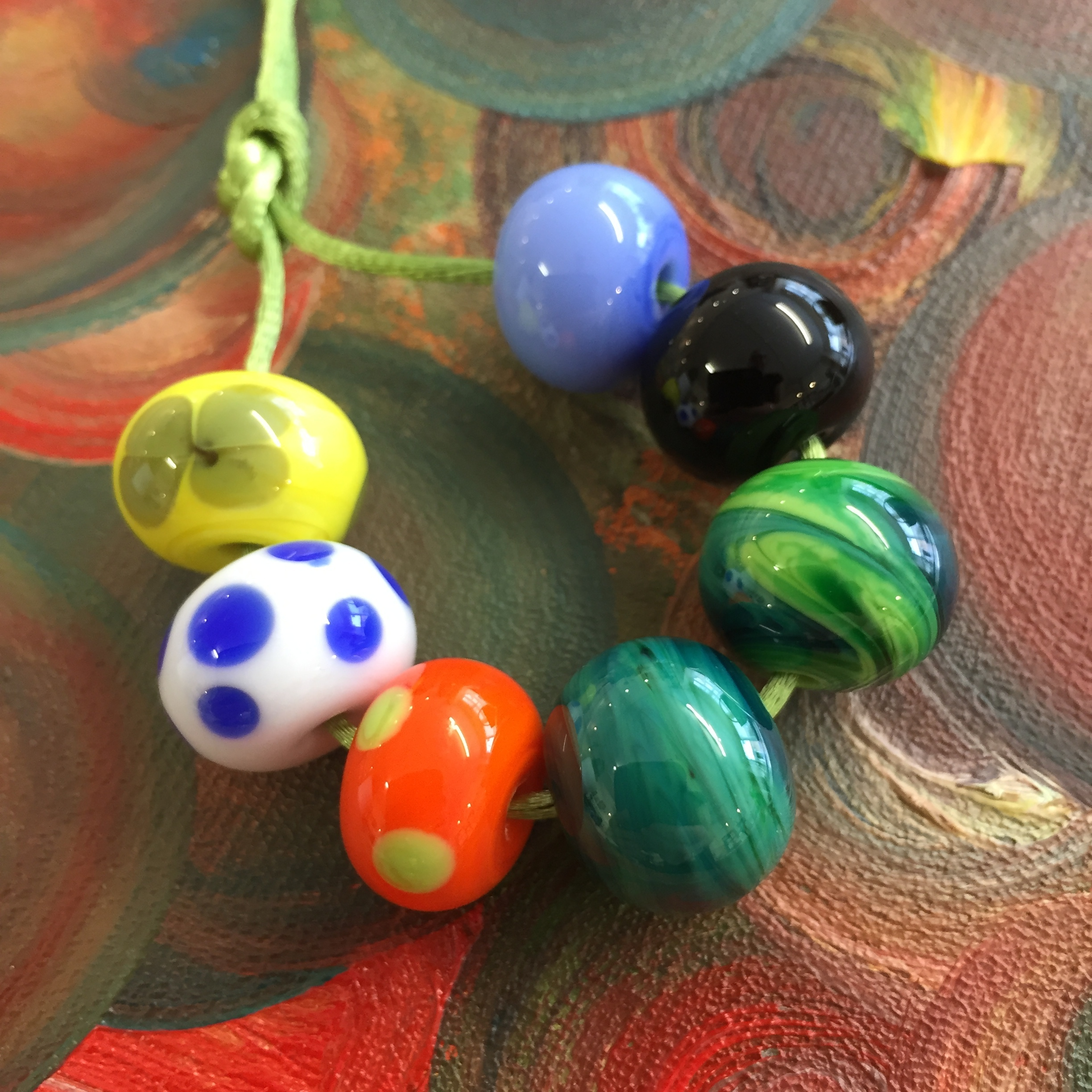 The finished beads, strung in the order in which they were made. First bead is at the one o'clock position.