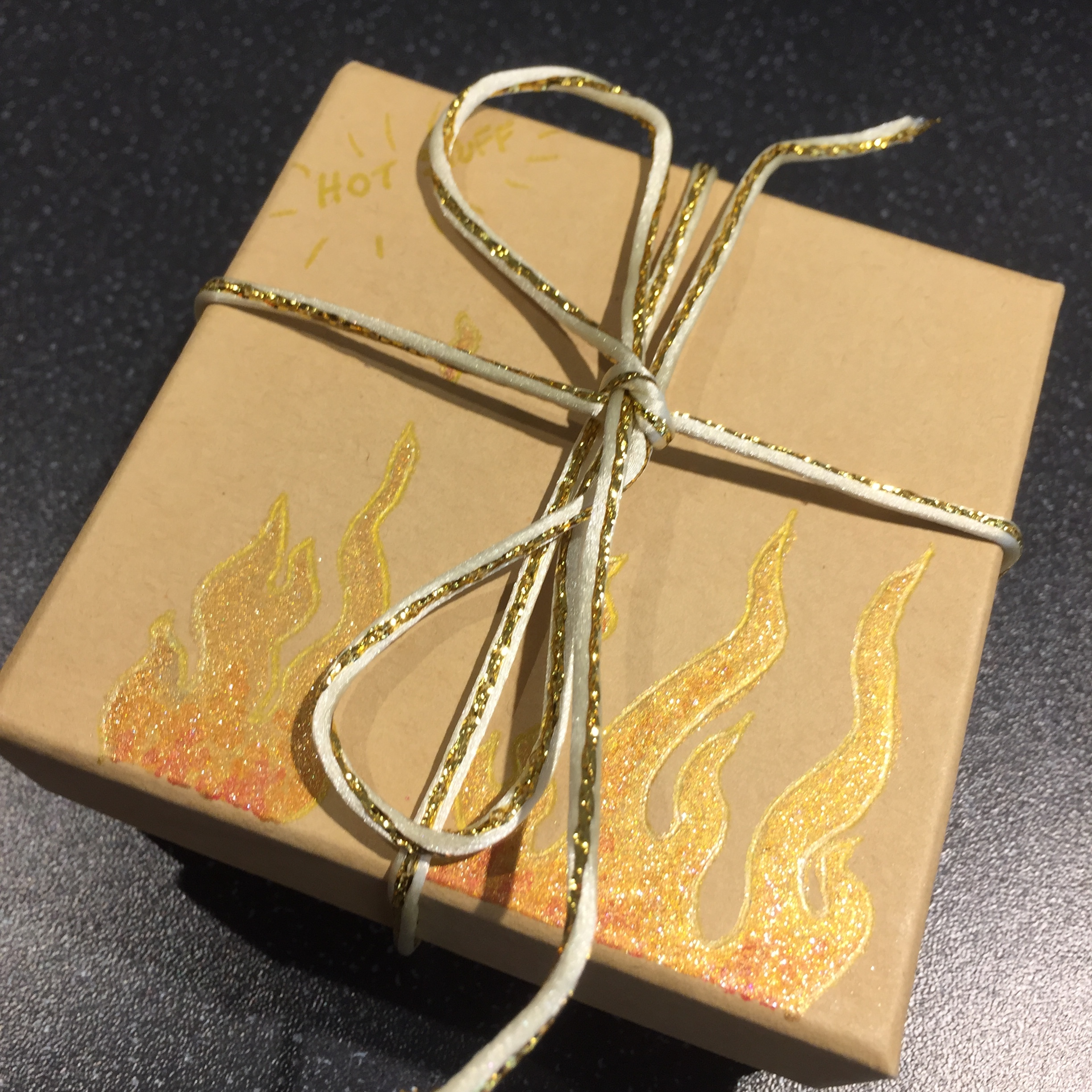 Hang on…. there was more! In a beautiful beribboned box painted with flames to match my logo, was this little guy….