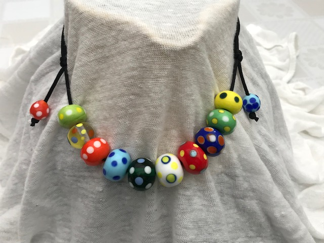 Theresa made these bright beads for her grandson. I love how she's put them together in this easy-to-wear necklet.