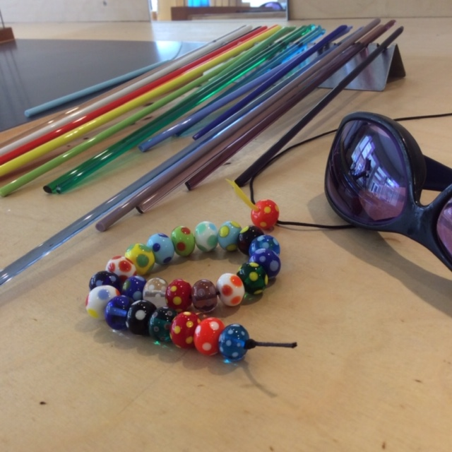 Sample beads on the workbench. Not every one of the 210 colour combination possibilities is shown!