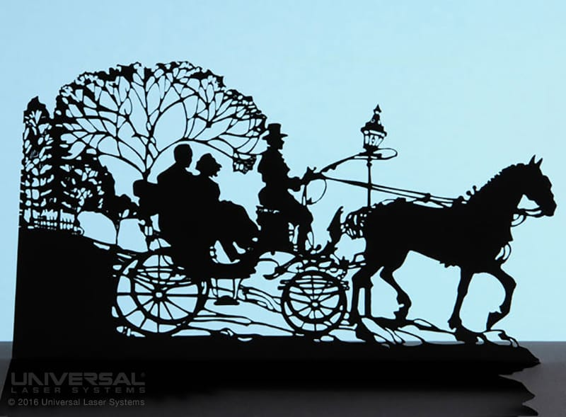 paper_based_materials_card_stock_laser_cutting_horse_drawn_carriage_sihouette_from_card_stock_with_a_10.6_micron_co2_laser