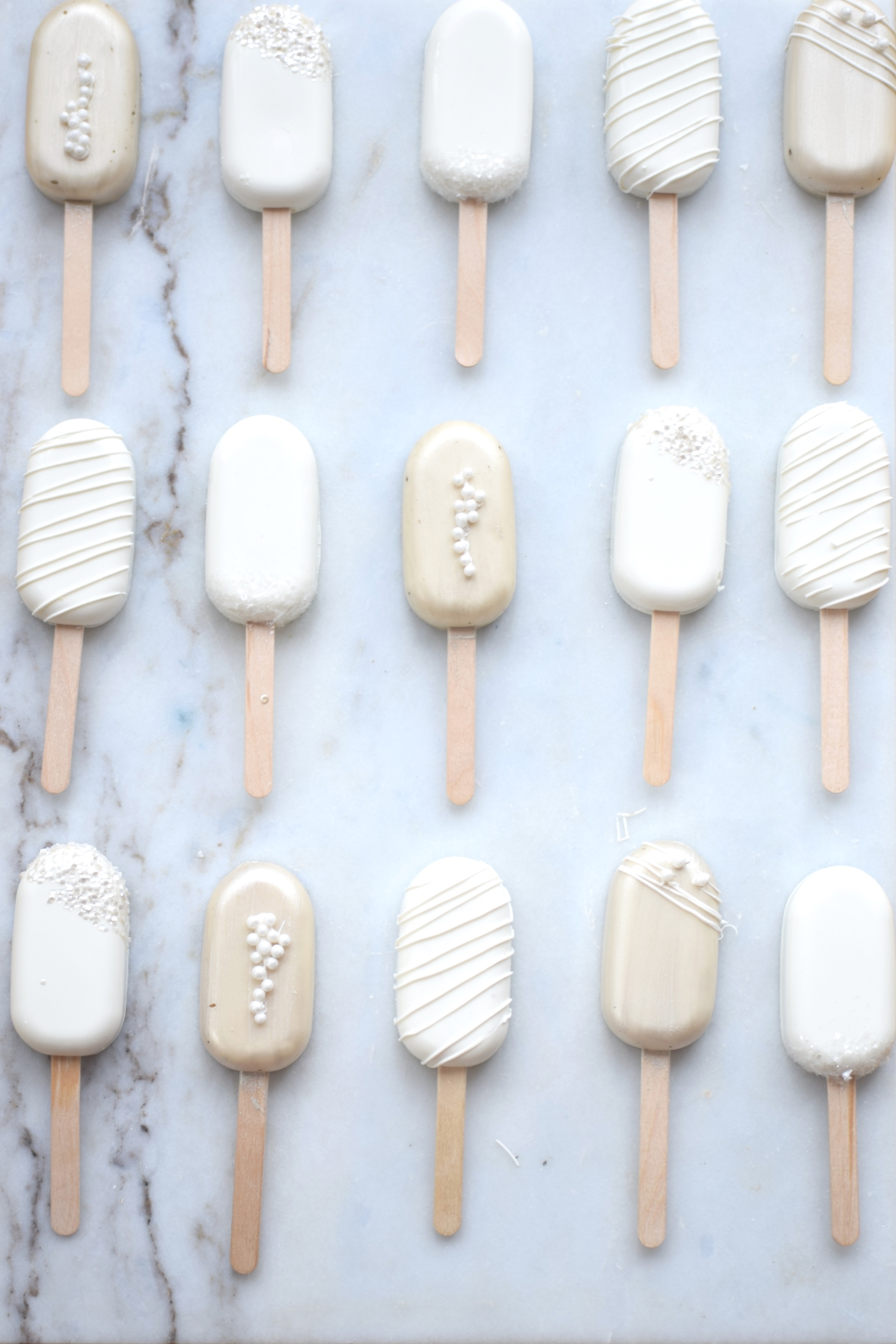 White and gold wedding cake popsicles