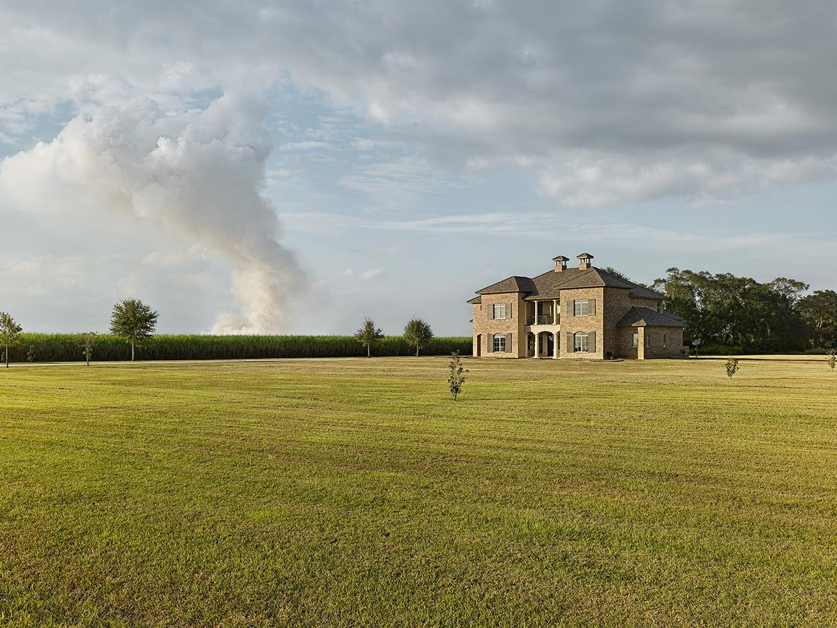 House & Burning Cane, Louisiana.jpg