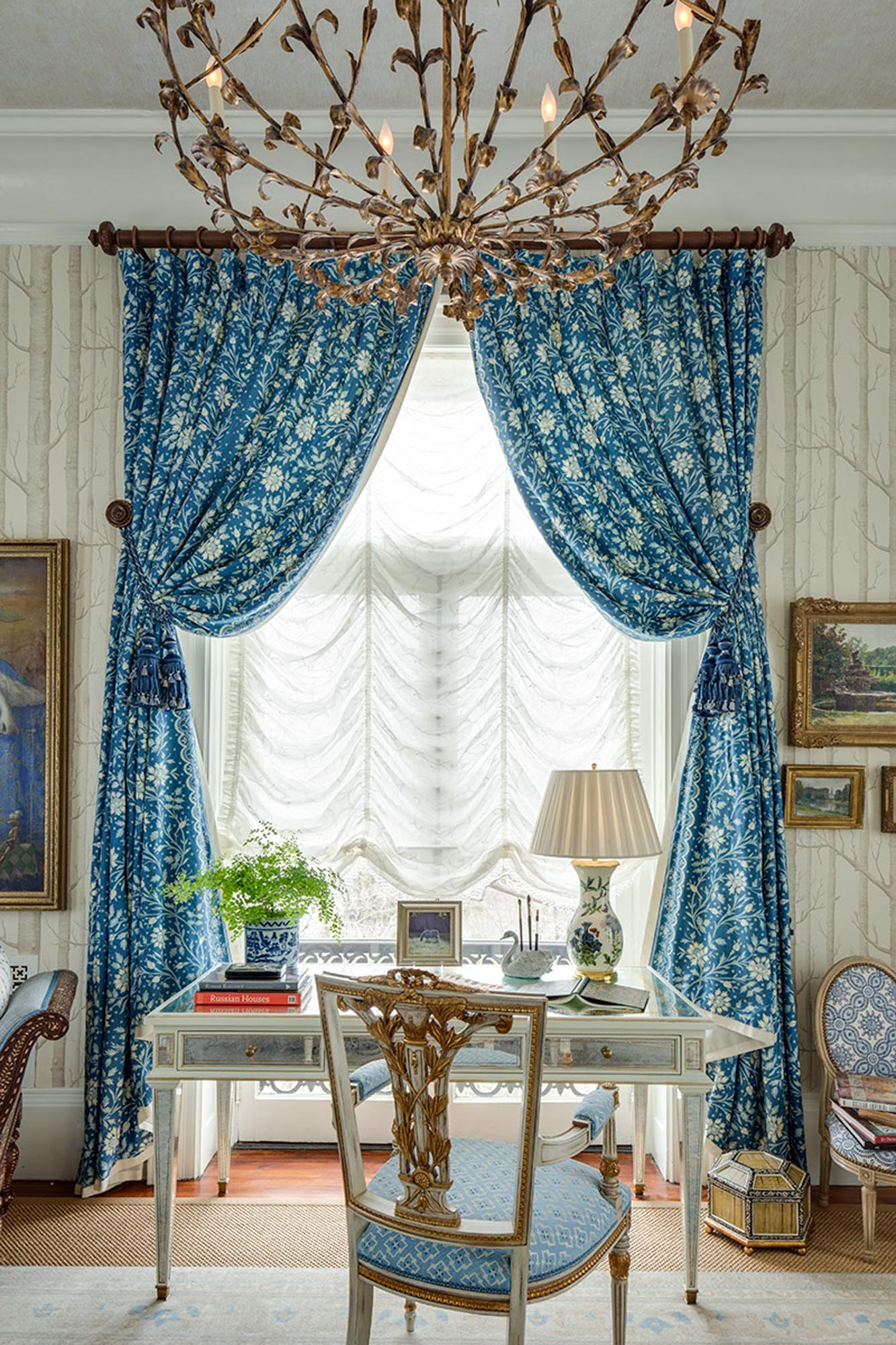 Living room with blue curtains and table