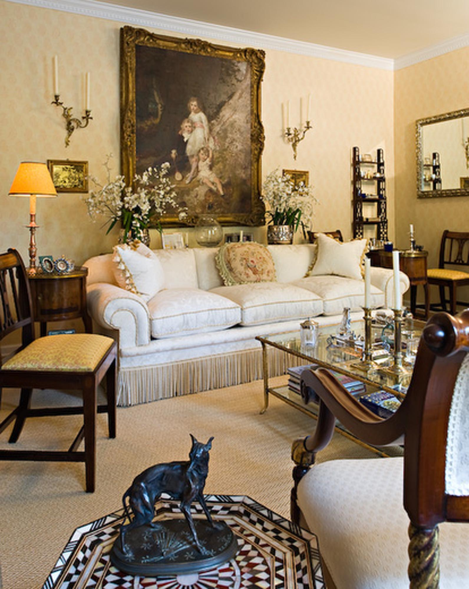 Luxury living room with big painting on the wall and classic display
