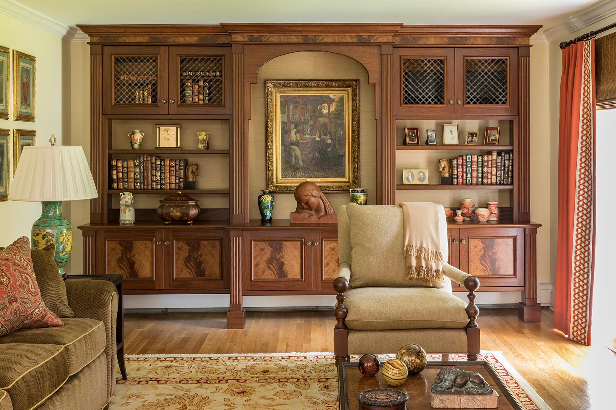 Spacious wooden cabinet with displays and chair