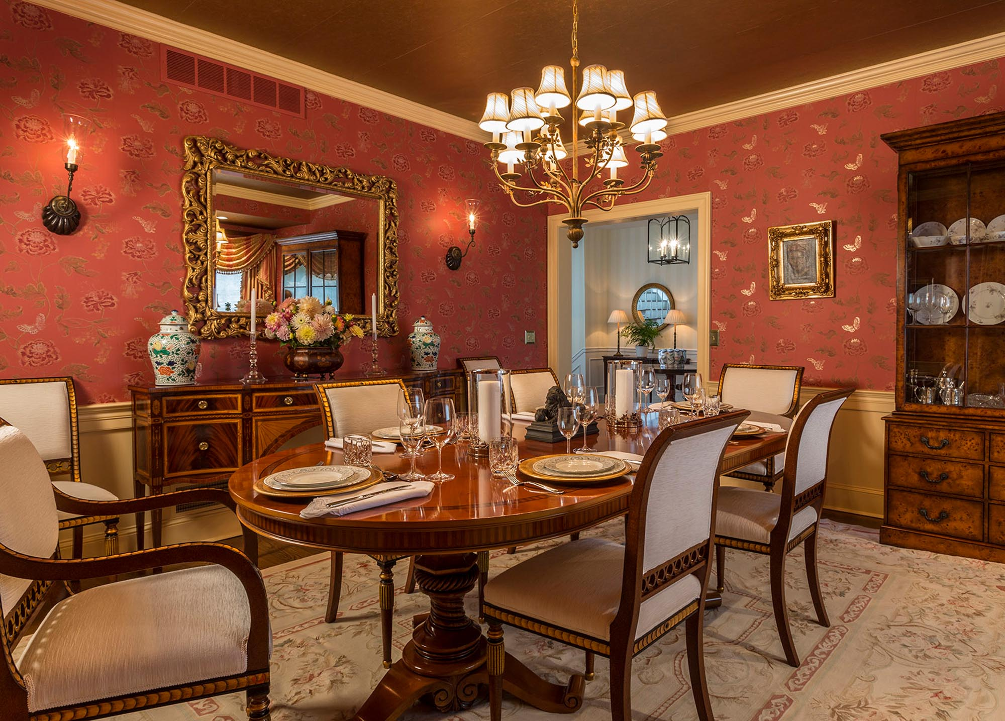 Warm dining area with wooden table for six and vintage chandelier