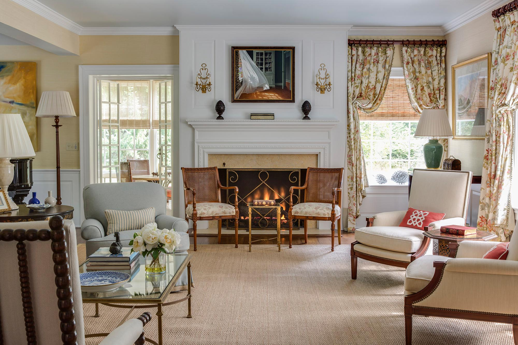 Warm living room with printed curtains and fireplace