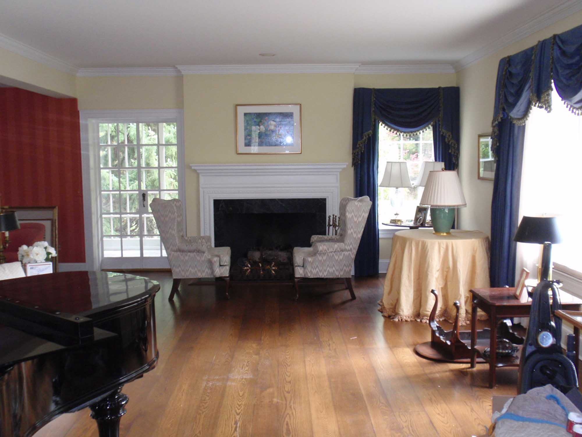 Living room with blue curtains and fireplace