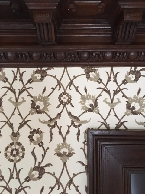 Stylish wooden ceiling molding and printed wall